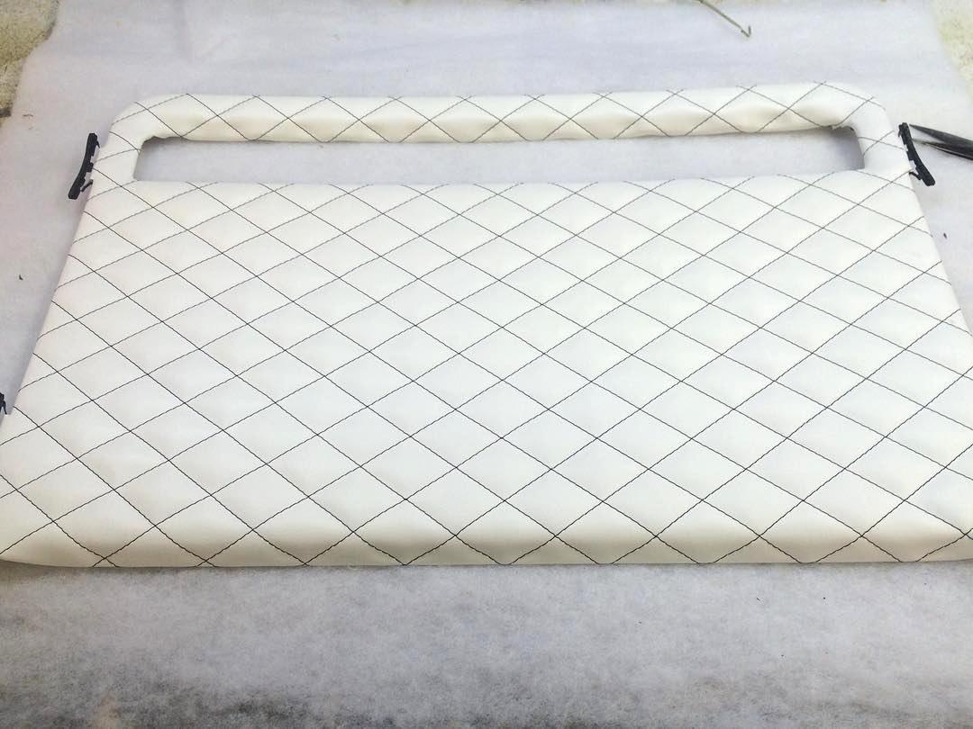 Custom White leather headliner - moon roof with black diamond stitching.