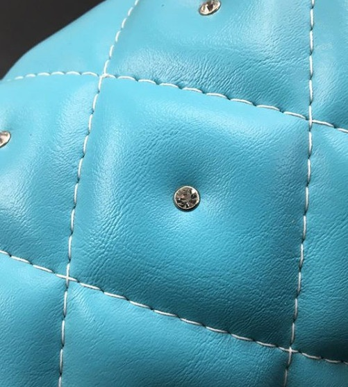 Custom Tiffany's blue tank diamond studded and diamond stitched tank wrap.