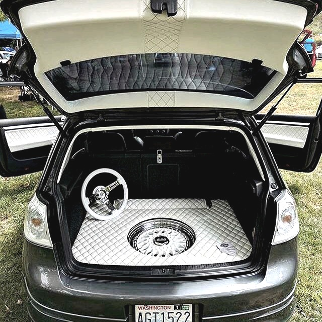 GTI Custom Trunk. White leather with diamond stitching and leather wrapped steeringwheel