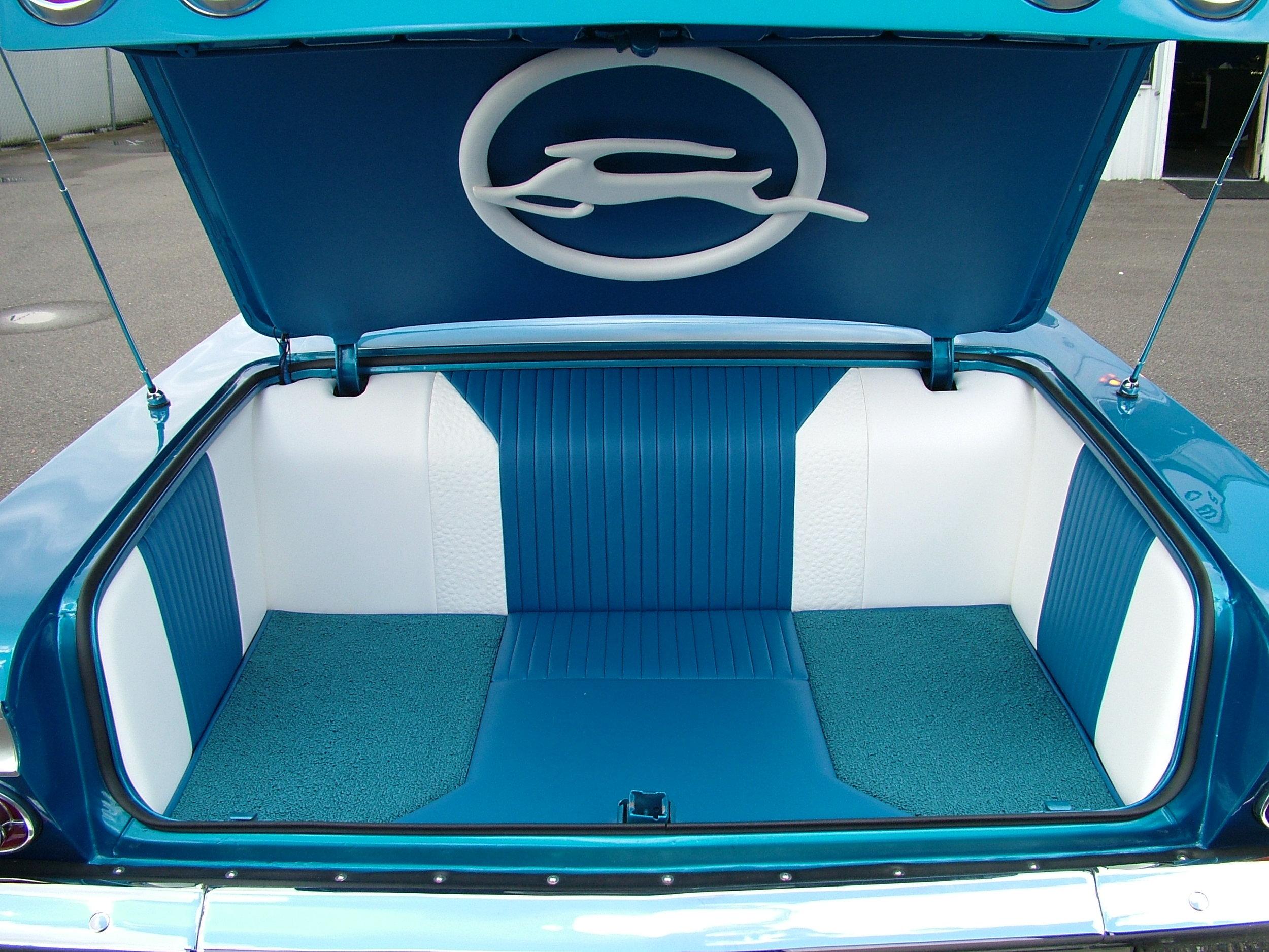 Impala - Custom Trunk, Blue and white stitched leather and custom carpet.