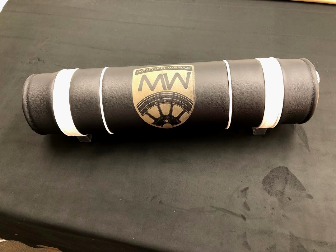 Custom leather wrapped tank wrap with Meister Werks emblem.