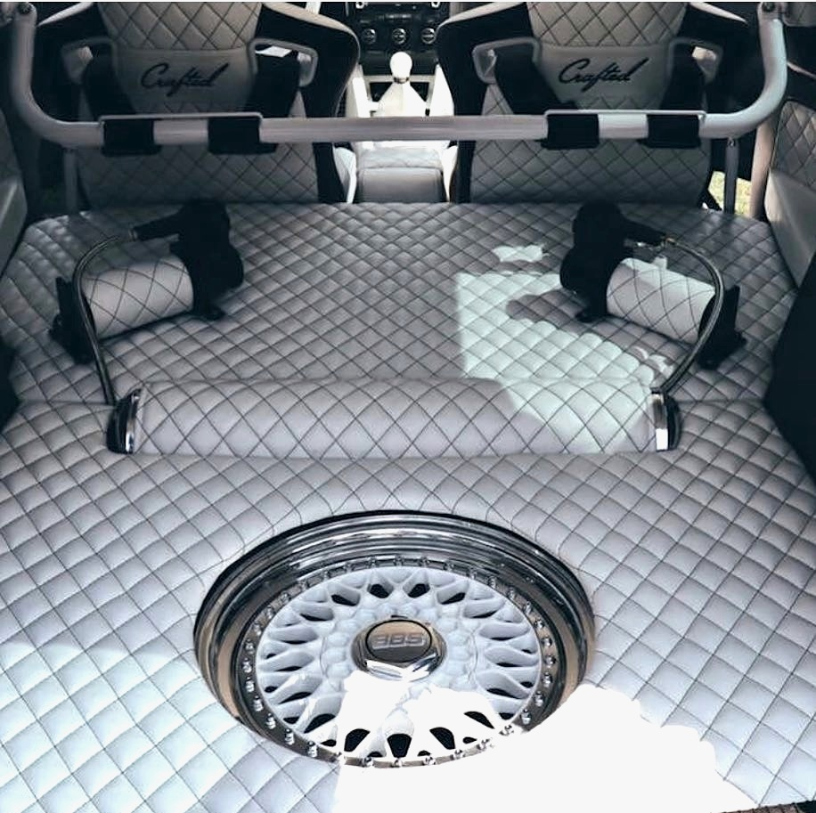 NW Crafted can customize anything from your seats to your trunk. Check out this fully customized trunk complete with white leather and diamond stitching.