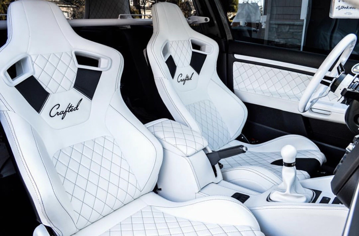 NW Crafted custom white on white leather racing seats with  high quality Alcantara suede and diamond stitched accents. Matching console, door panels, leather wrapped steering wheel, and shift boot.