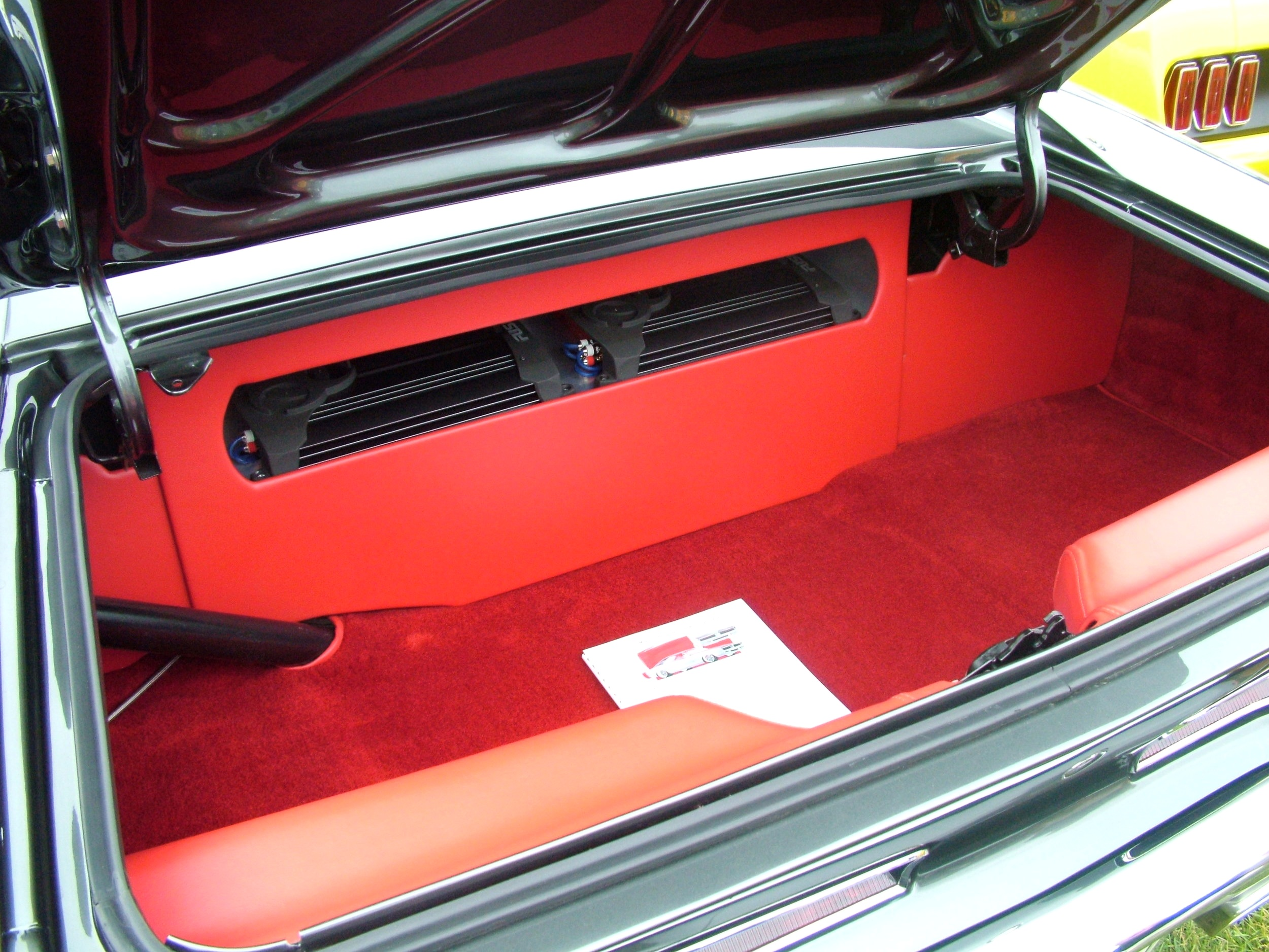 Charger- Full custom interior with custom red carpet lined trunk.