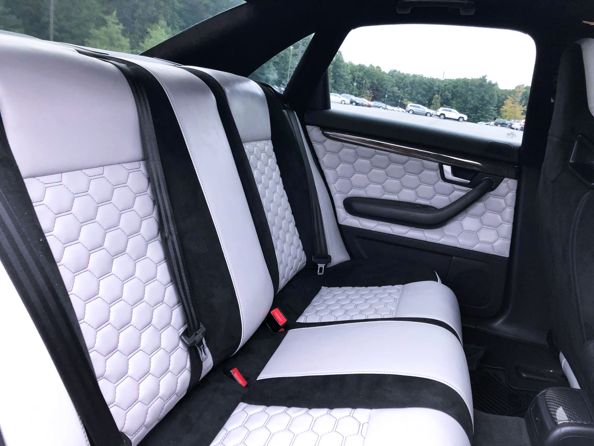 2006 Audi S4 - Full custom interior with hexagon stitching and black micro suede seats and door panels.