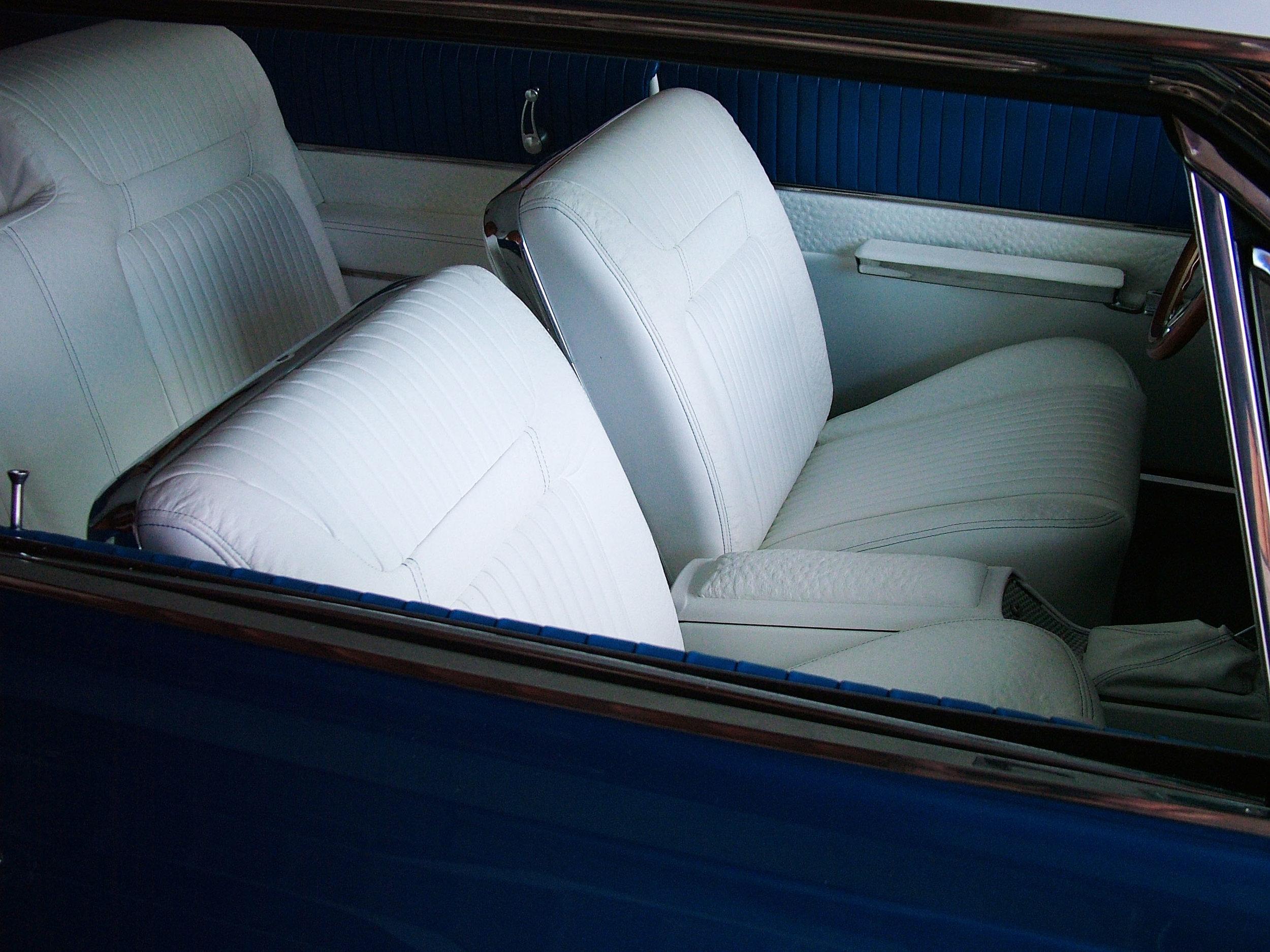 Full custom Impala interior with white leather bucket seats.
