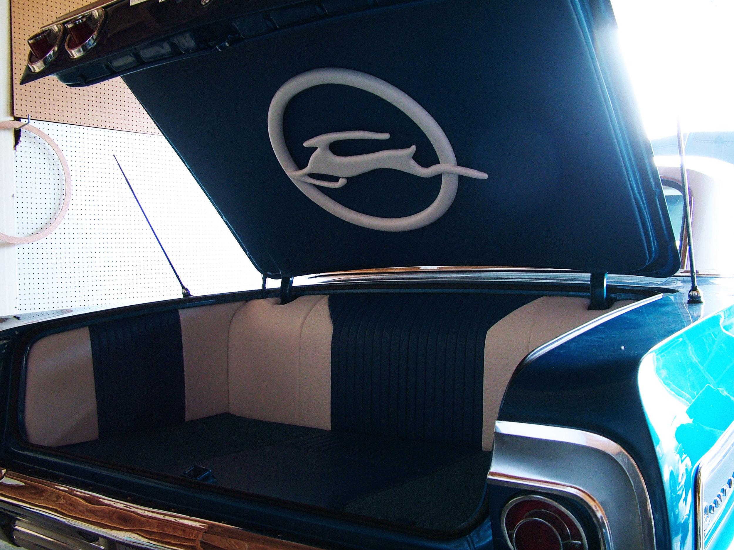 Full custom blue and white leather trunk with custom Impala logo.