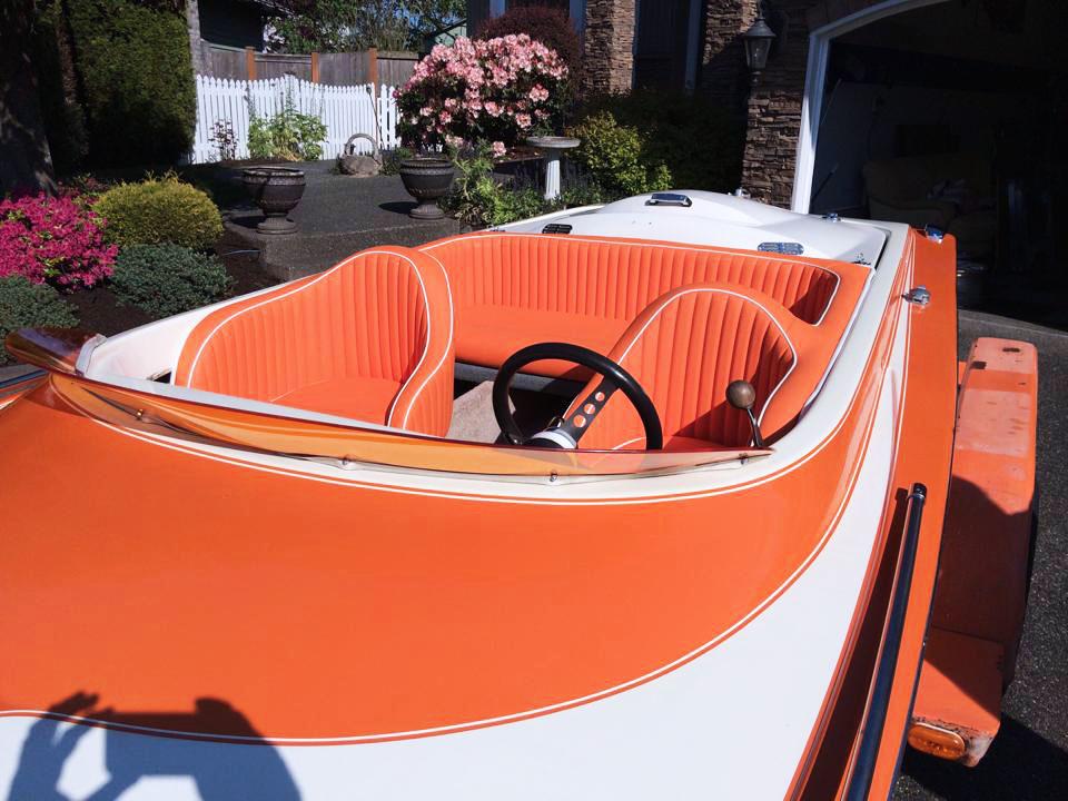 Full custom speed boat interior - custom orange and white lined leather seats.