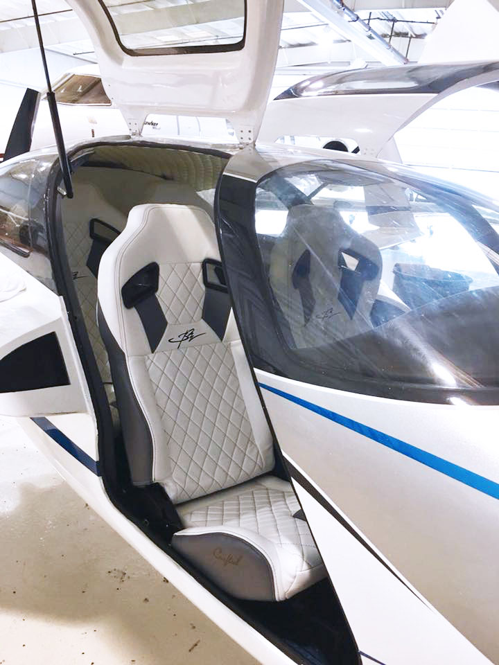 Custom Airplane interiors - White leather diamond stitch.