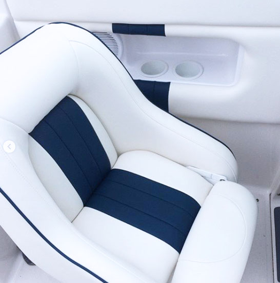 Custom speed boat interior - white and blue leather wrapped boat seats and side panels.