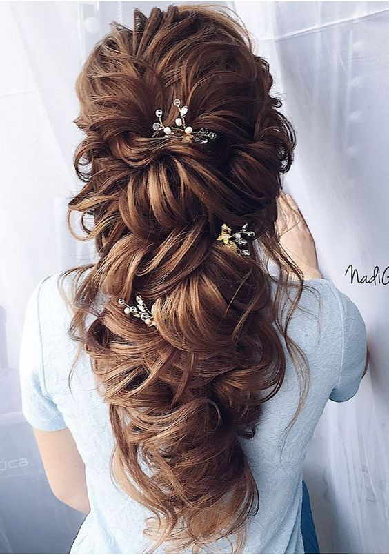 - This large boho princess bridal style has been the number 1 hair request for my 2019 brides. This style makes people think your hair is down, but is actually a sneaky way to keep it off your shoulders and face! It requires a lot of hair extensions to get that super full look, unless you have naturally thick hair. Poke a few simple hair accessories through these tousled curls and you've achieved the most feminine look!