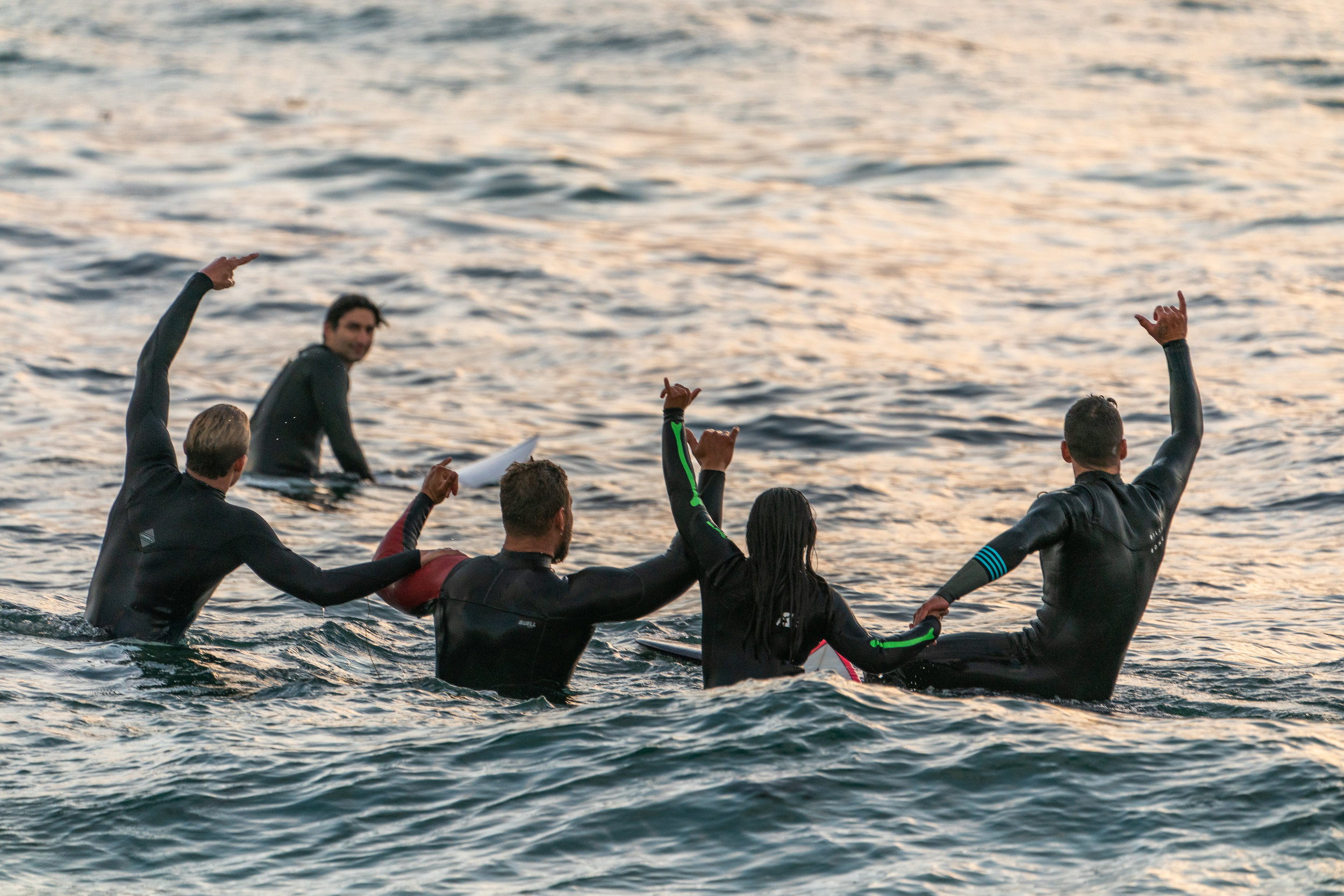 Every week they go surfing together, they raise $5 for the Challenged Athletes Foundation -