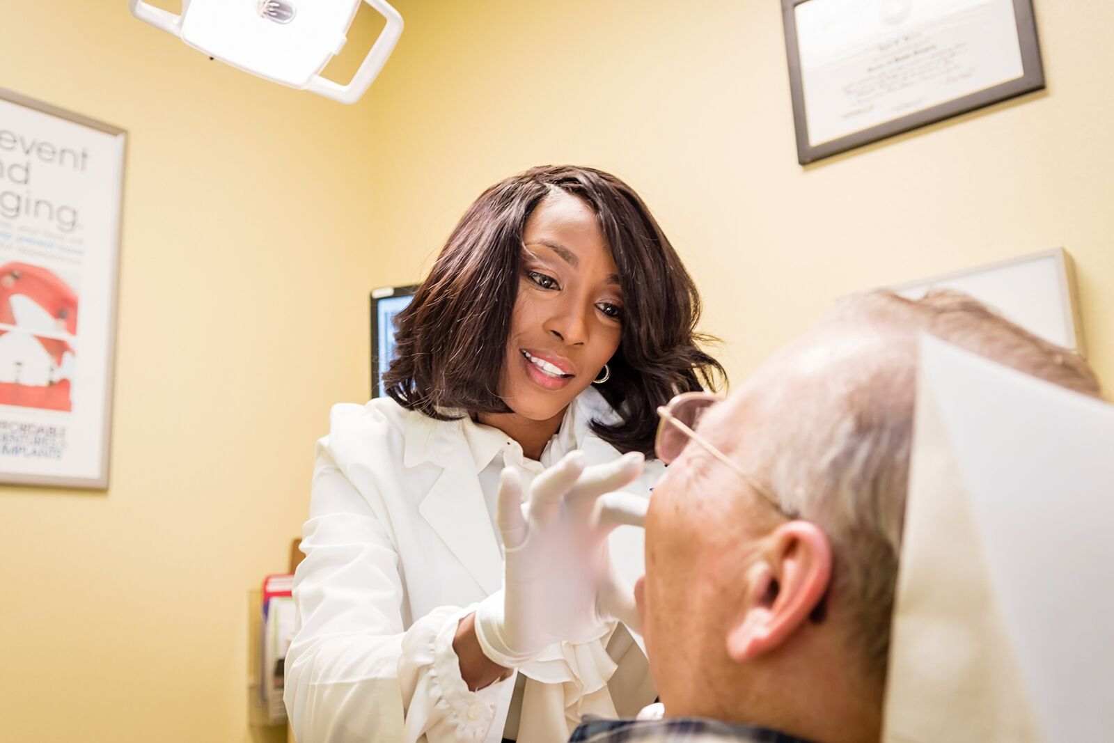 Dr. Adedoyin, an affiliated practice owner at AD&I uses her smile to put patients at ease.