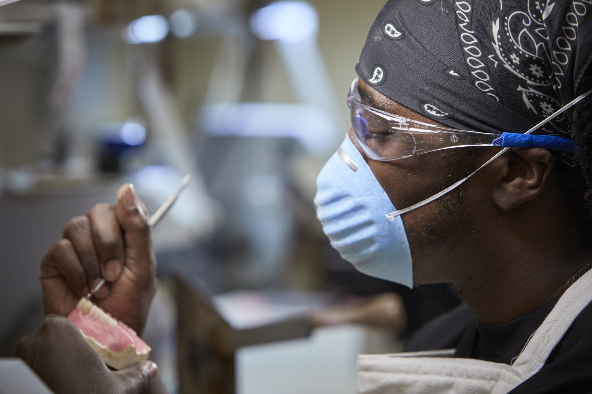 AD&I Lab Manager, Aaron Taylor, customizing a denture in the on-site lab.