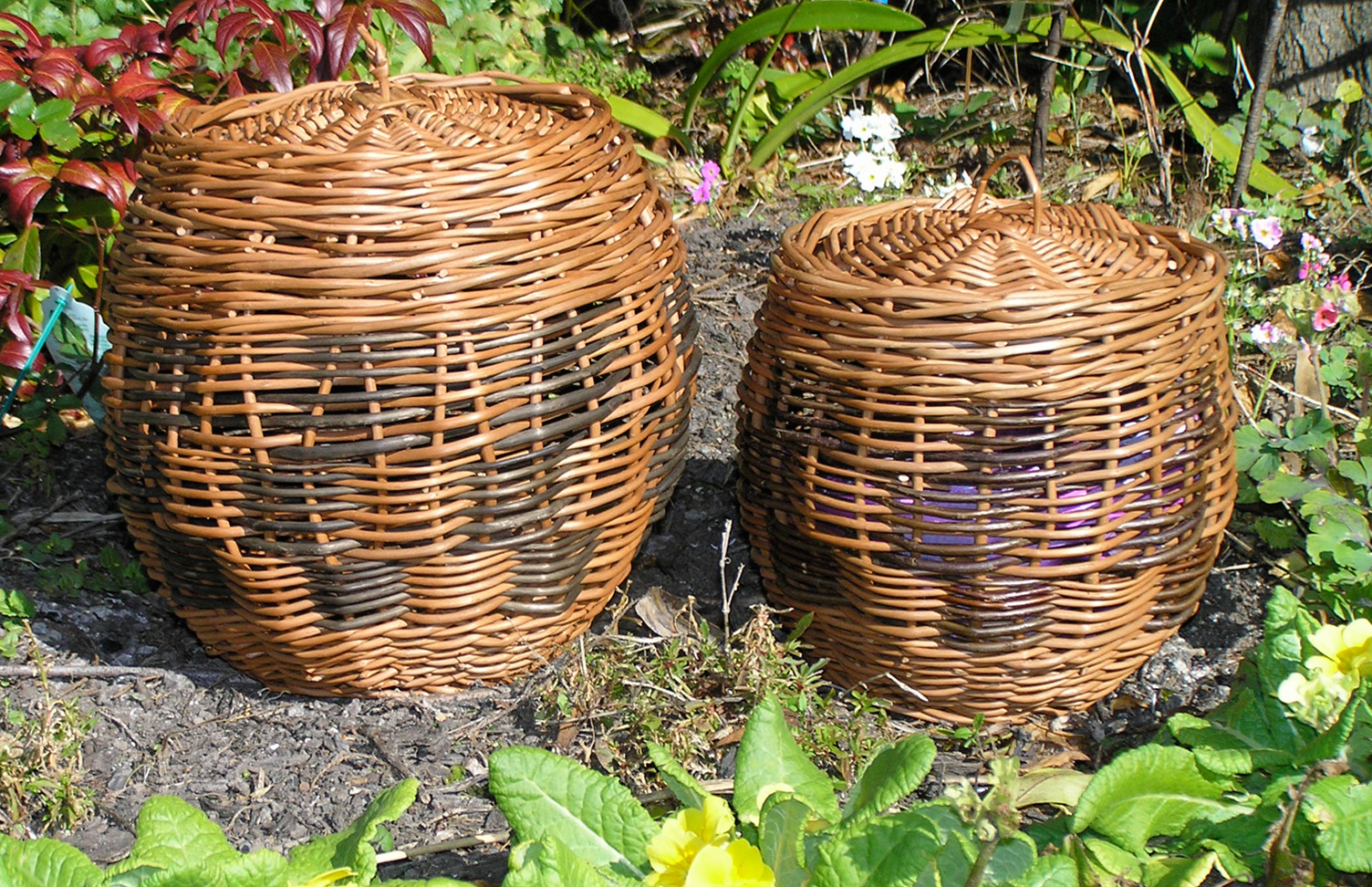 Pair of decorative baskets with lids