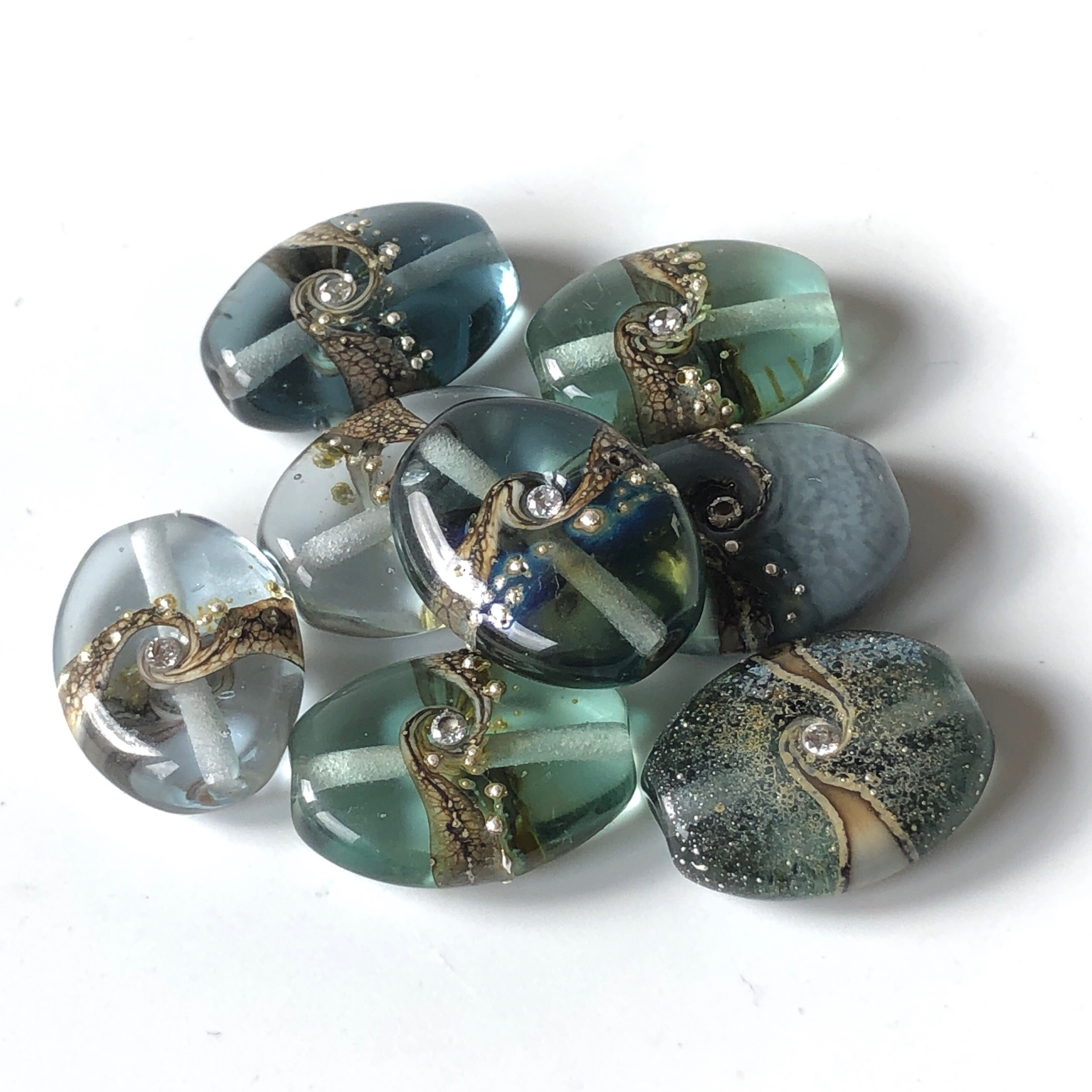 Grey lampwork glass beads with cubic zirconia set in the middle
