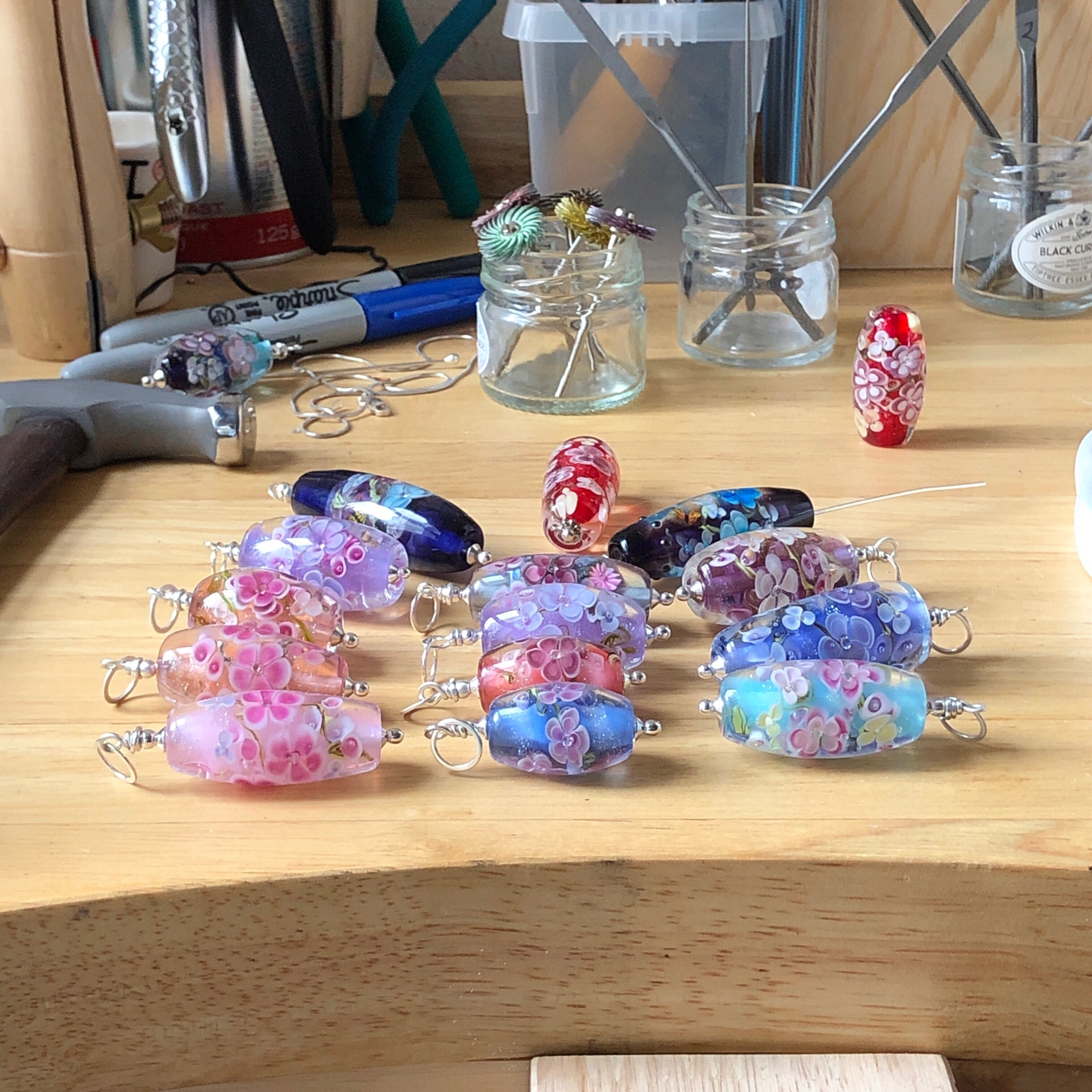 Floral beads on jewellery bench.jpeg