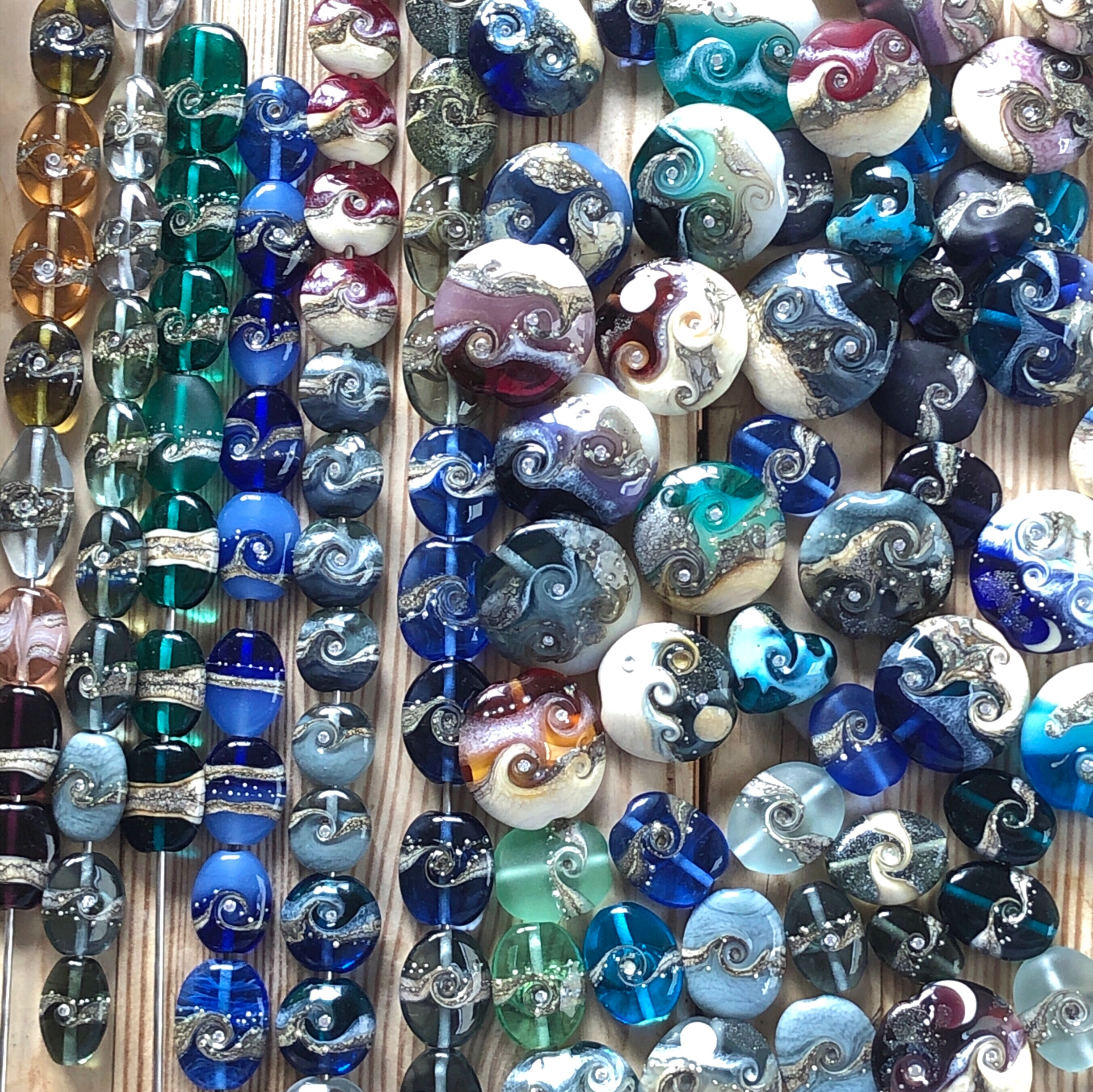 Mostly blue, grey and teal lampwork beads