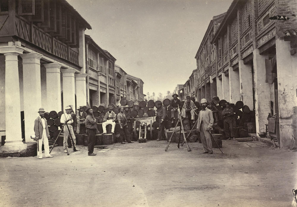 A photograph depicting European residents behind the log barricade taken during the 1867 Penang Riots. The photograph is included in the album presented to Prince Alfred, Duke fo Edinburgh by Bishop of Penang in rememberance of his 1869 visit. Royal Collection Trust.