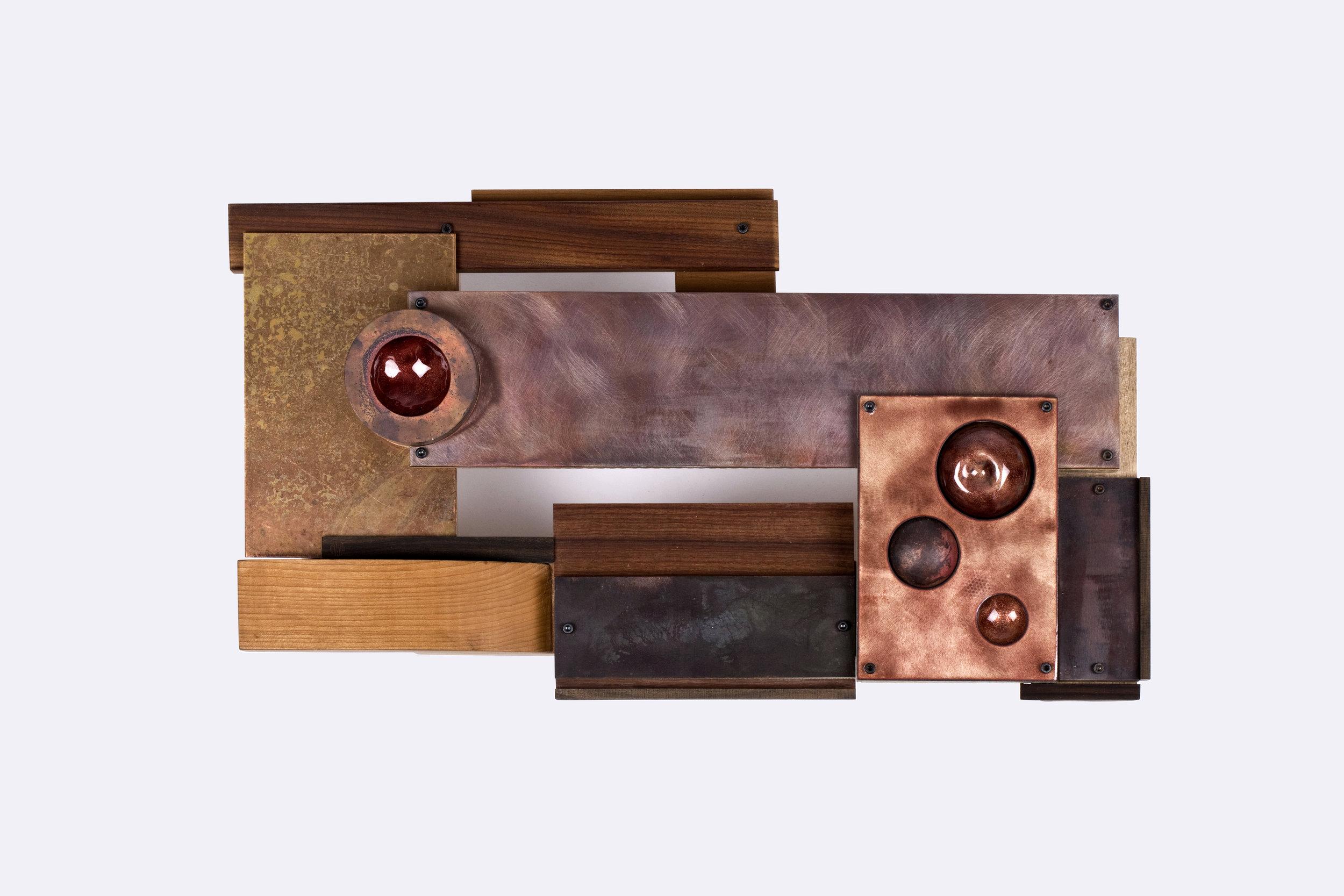 Med eller mot    Wall sculpture, 2018   25x46x8cm   Materials: Wood, copper, brass, steel, enamel.  Photo credit: Aliona Pazdniakova
