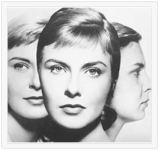 "Image Description: Black and White composite photo from the movie poster of ""Three Faces of Eve"". First woman on left is blonde, facing forward, and smiling. Second woman on right is facing right, frowning, dark hair, more matronly. They are in the background. In the foreground is overlapping picture of more elegant woman facing the viewer."