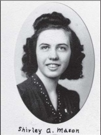 "Image Description: this is a school yearbook type black and white photo in oval frame of a young woman with dark hair curled on top and on each side of her face. She has a bright expression, and is wearing a dark dress that has some decoration around the collar. There is handwritten lettering beneath the photo that says ""Shirley Mason""."