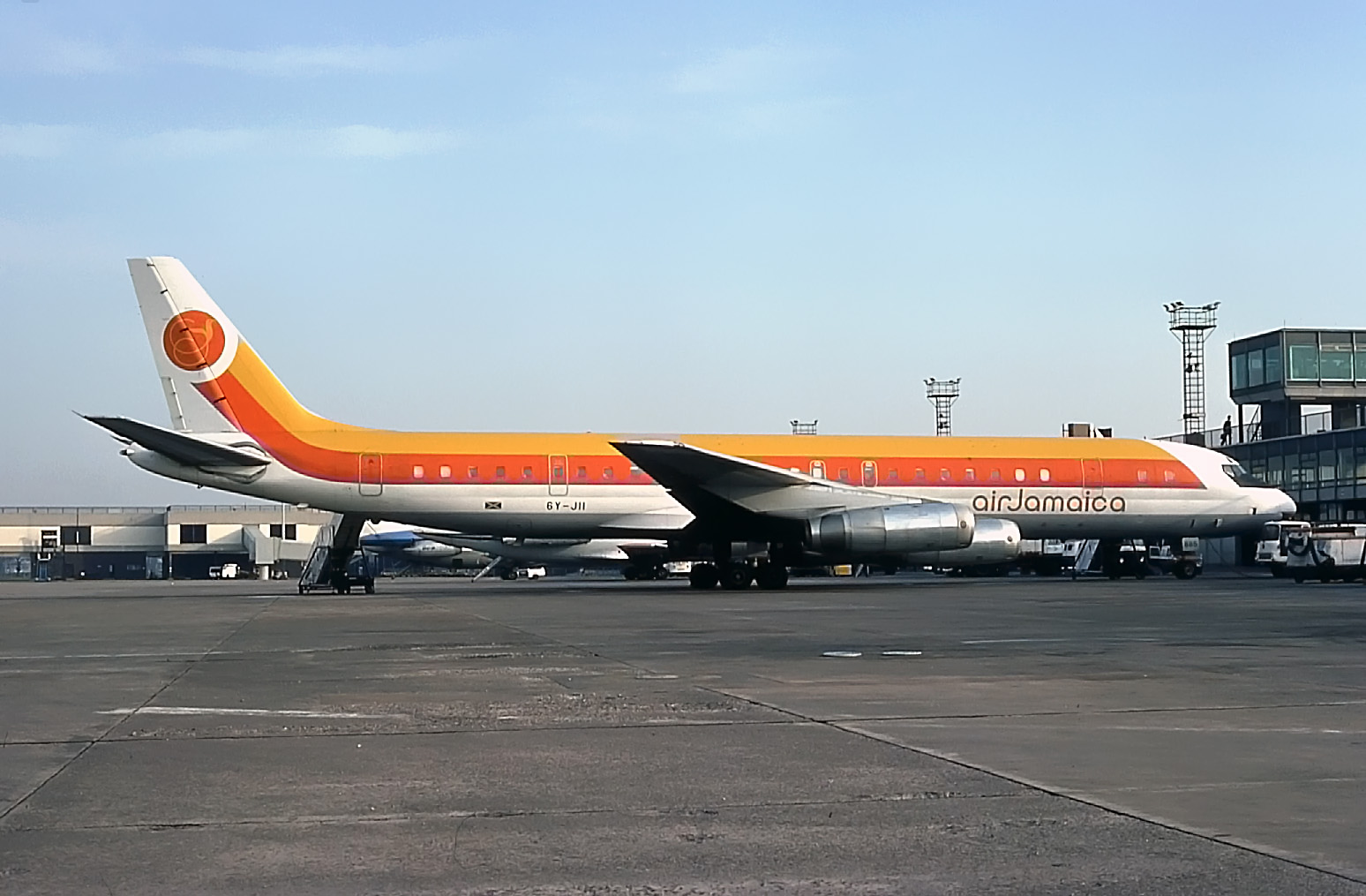 How to brighten up your day? Jamaican DC8-62 6Y-JII diverts in from Heathrow on 7th March 1977.Photo Peter H