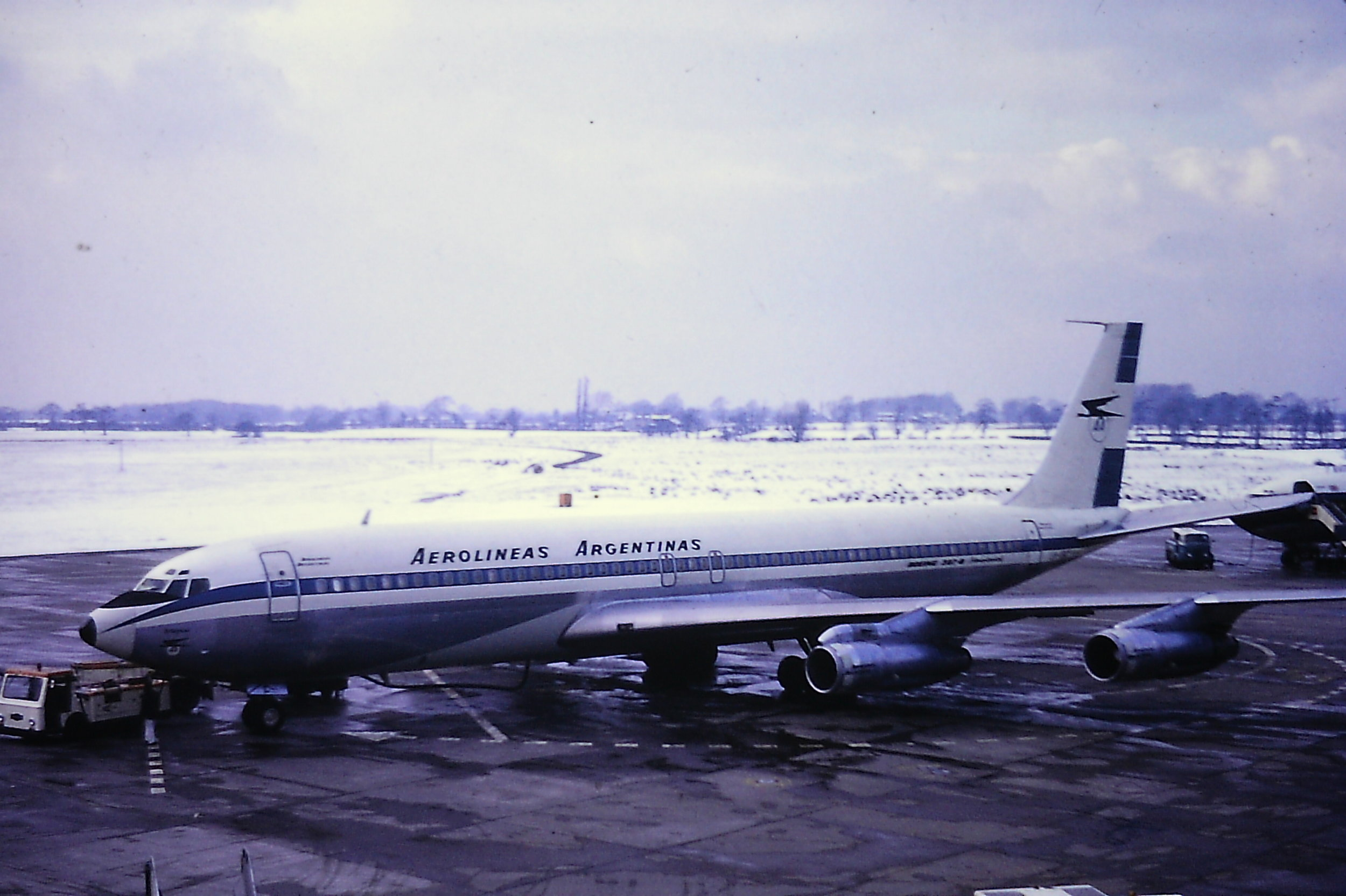 4th March 1970 turned into being a classic in bound diversion day for Manchester due to heavy snow in the South of England. Probably the pick of 25 aircraft which diverted in was this Aerolineas Argentinas Boeing 707 LV-ISC - seen here on Pier B. A huge thanks to Eric Wright for sharing this wonderful memory. In these days the chemical Urea (don't ask!) was spread on the aprons as an exceedingly effective de-icer…as you can see!