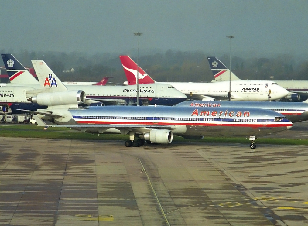 A great shot from Stuart Prince which really does capture a moment in time at MAN.Packing those diversions in, B747's,American Airlines and even a BAC 1-11 creeping in on the photo! The main subject is of course the MD11 N1763 but whats taking place in the back ground is just as interesting…17th March 1999.Super shot from the T1 Multi Story…oh dear 20 years ago!