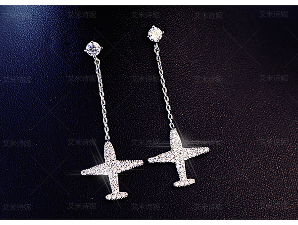 - Rhinestone Airplane Ear-Rings £15.00