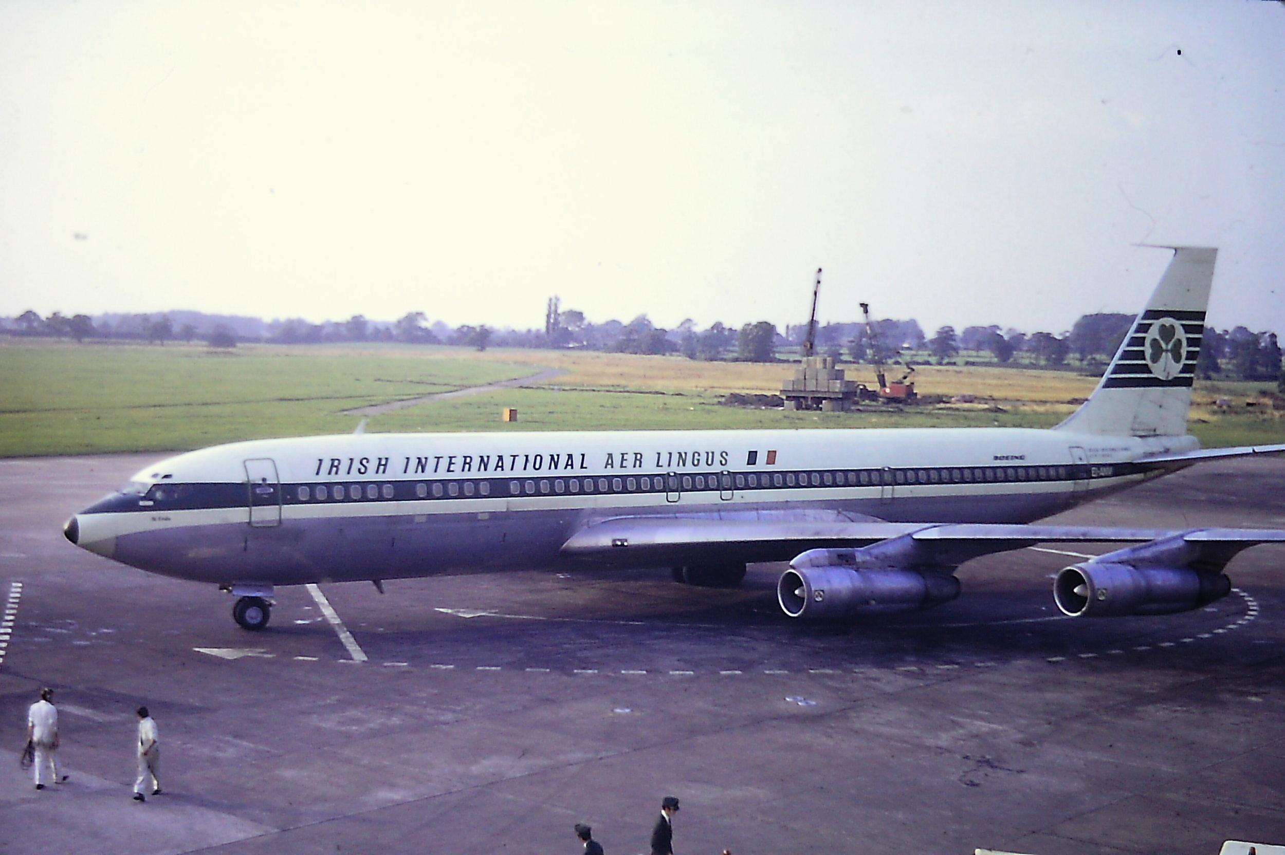 A wonderful shot of an Aer Lingus Boeing 707 EI-ANV taken from the top of the Pier B terraces by Eric Wright in April 1971