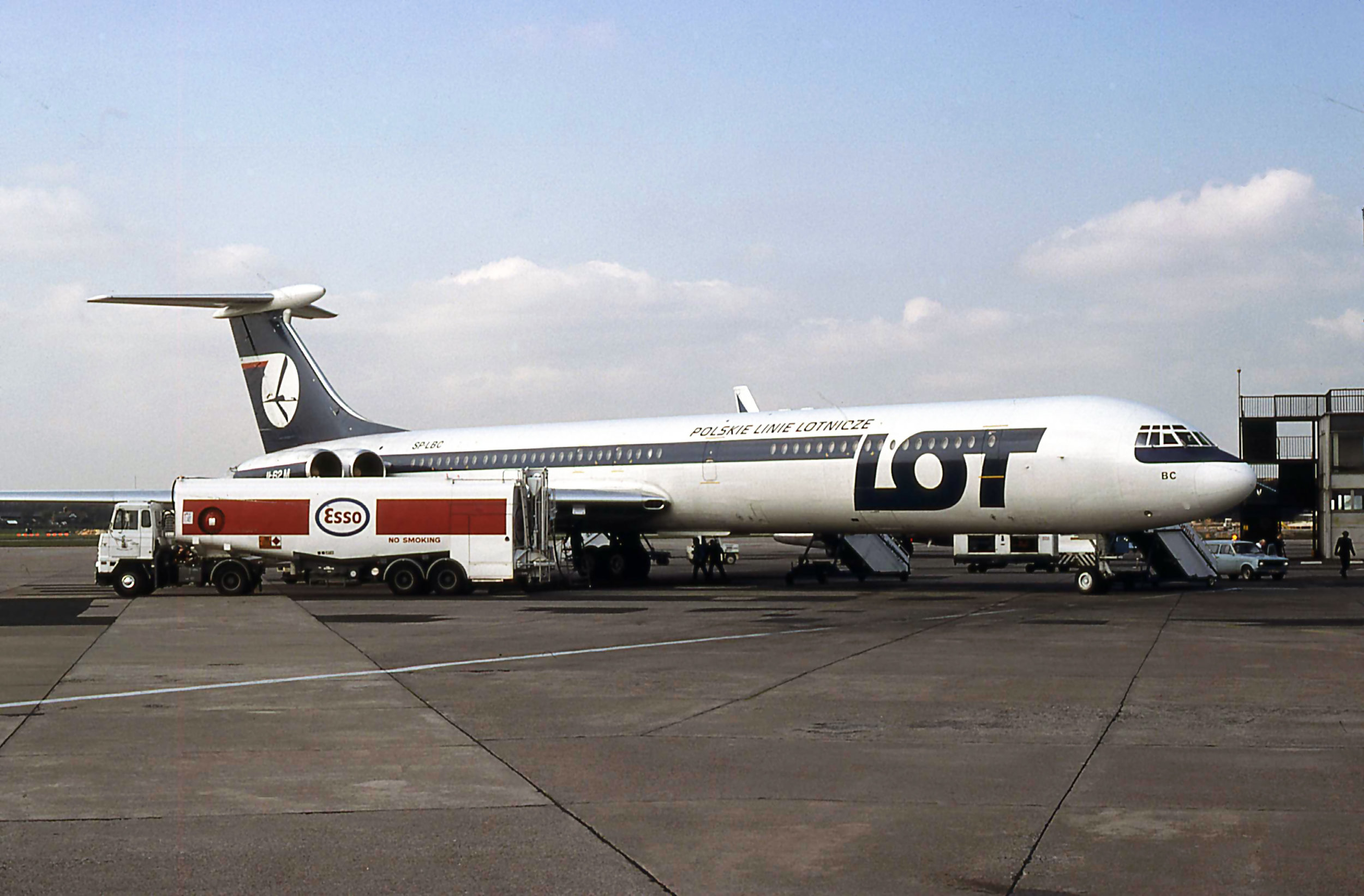 LOT IL62M SP-LBC takes on fuel from the Esso Bowser at the end of Pier B.April 1981 - Photo Peter H.