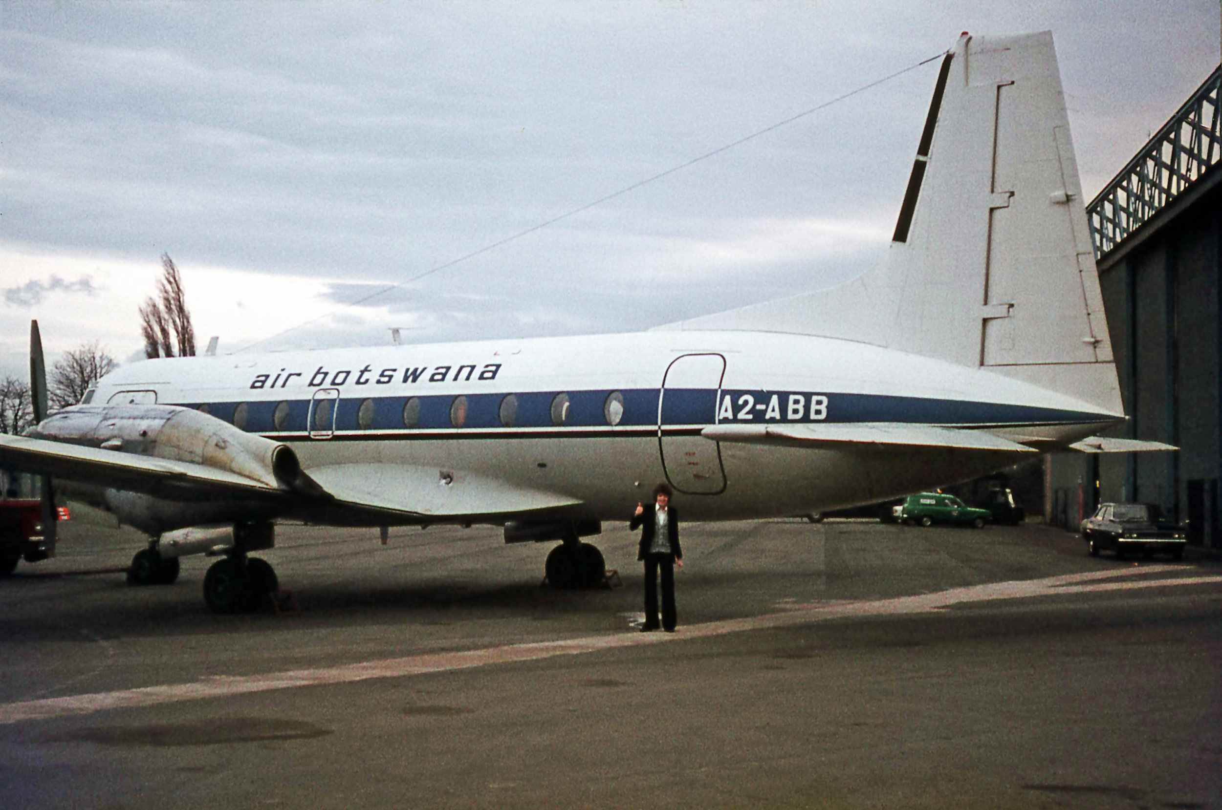 Air Botswana Avro 748 A2-ABB is seen here outside of Dan Air's Hangar 4 in April 1976. My apologies for doing a bit of photo bombing on the photo…goodness me… Get your hair cut young man!!