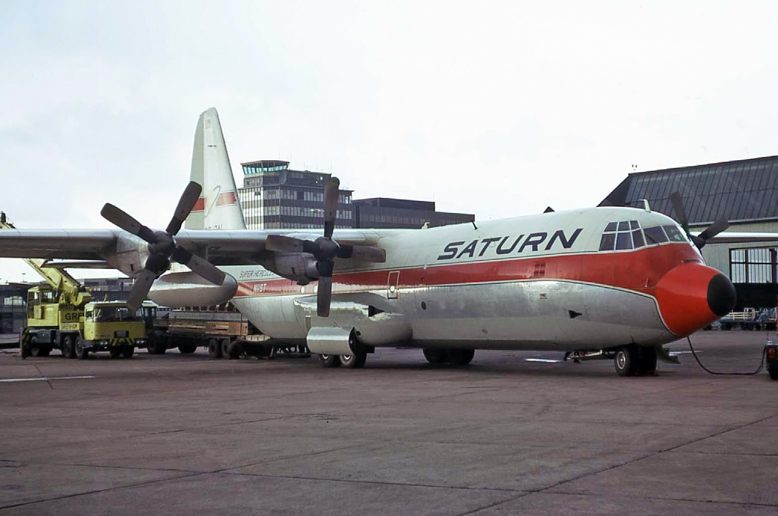 A classic shot of a Saturn Herc N11ST taken on the old freight apron on 15th April 1975.The aircraft arrived from Milan and departed to Sofia. Photo Peter H
