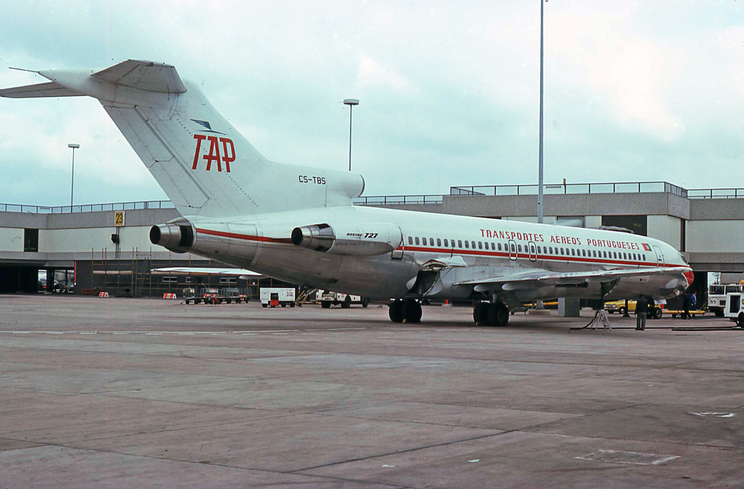 TAP Boeing 727-200 CS-TBS is seen here on Stand 21 Pier C in April 1976. Photo Peter H
