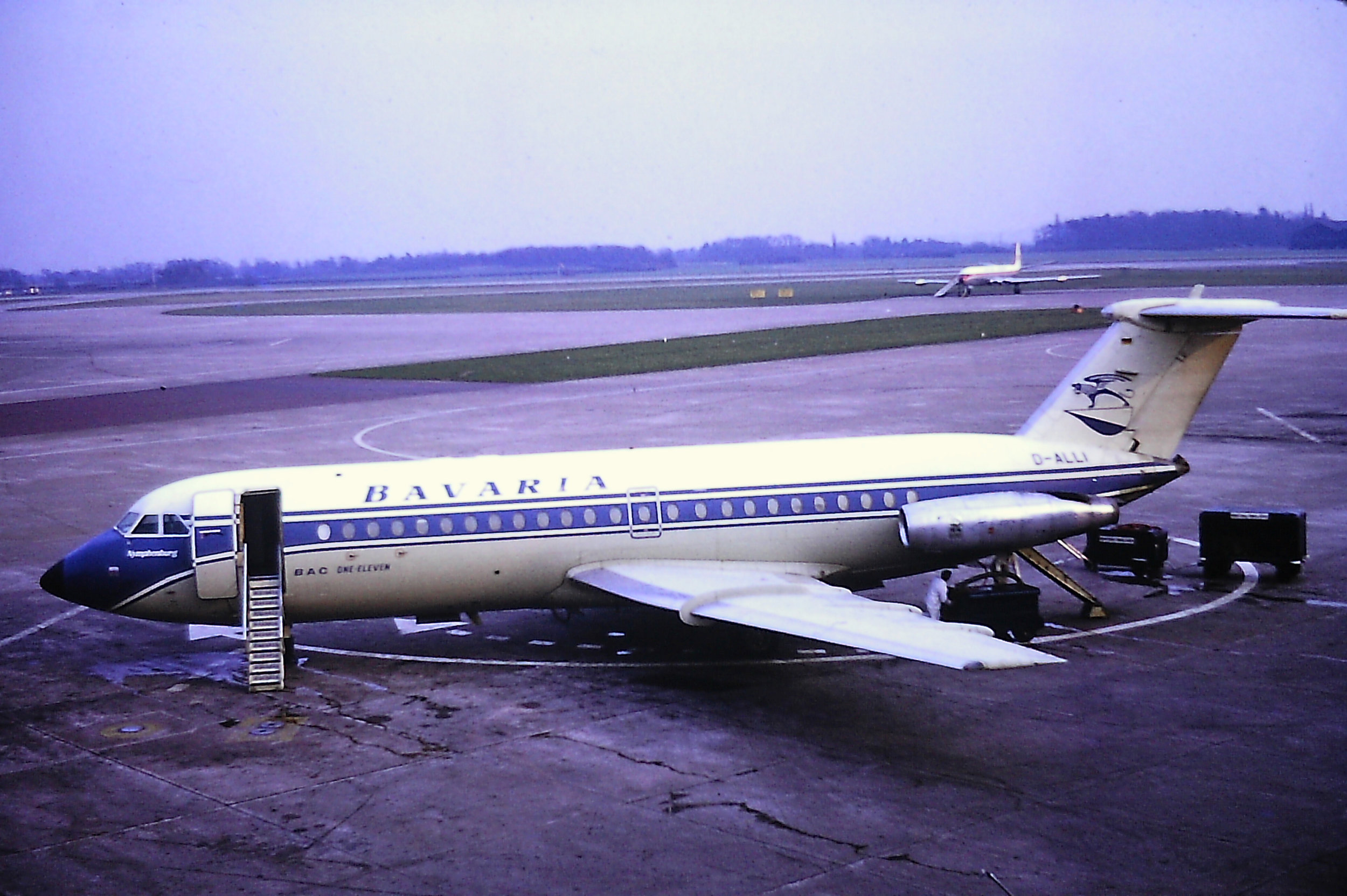 "Quite a rare shot of a Bavaria BAC 1-11400 at Manchester with thanks to Eric Wright. D-ALLI is seen here parked on a somewhat ""contaminated"" stand on Pier B -11th April 1971."