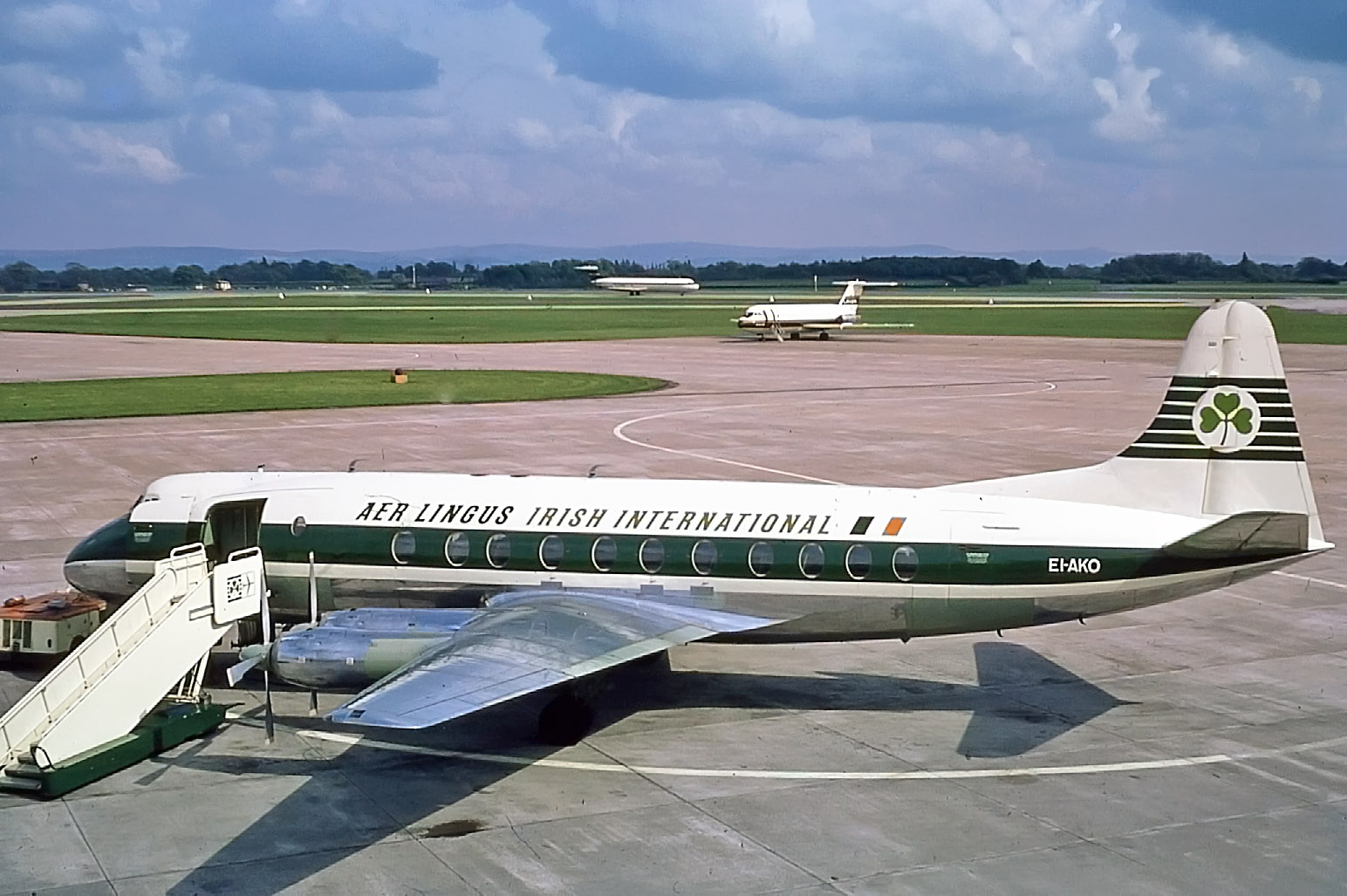 Aer Lingus Viscount EI-AKO looks good on Pier B with a Laker BAC 1-11 in the South Bay and new BEA Super 1-11 division aircraft just to the rear on Runway 24. Bob Thorpe May 1969.