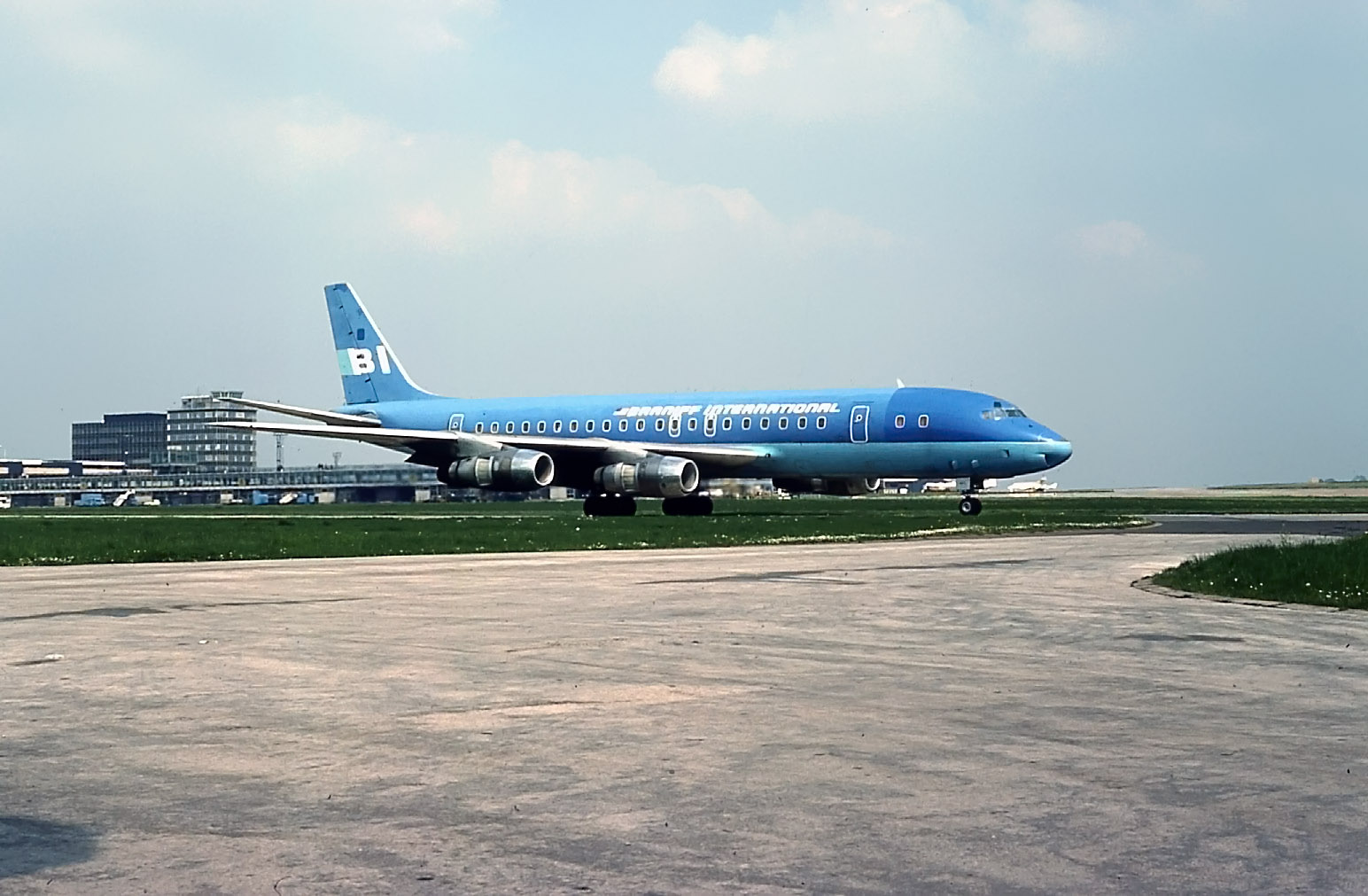 "19th May 1978 was the day when Braniff ""blue"" Dc8-51 N813BN visited us on a US Forces Trooping flight. It was returning troops to Texas following a NATO Exchange exercise with some of our boys from Weeton Barracks near Preston. Photo Peter H"