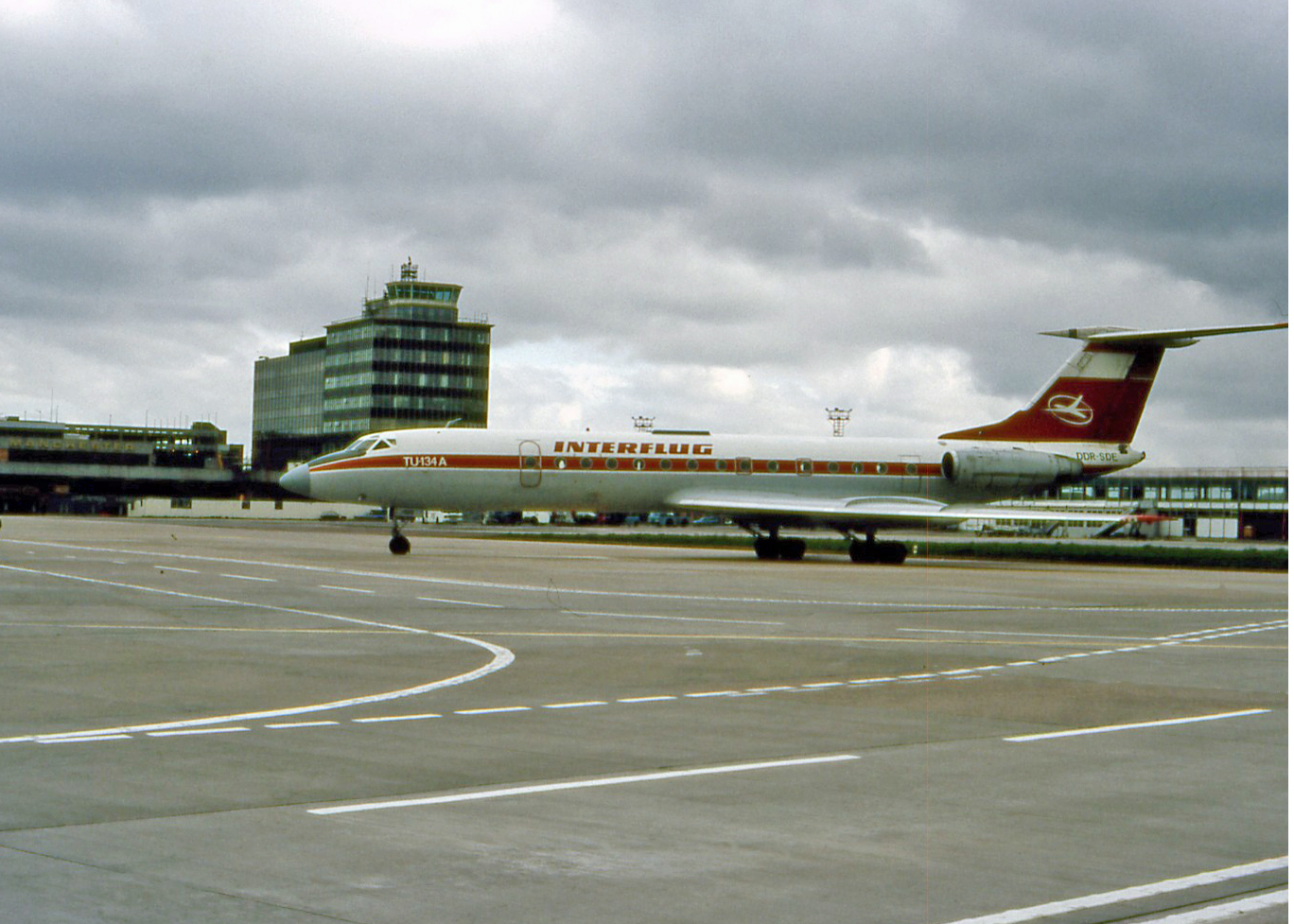 Interflug aircraft were always something special in Manchester. 3rd May 1987 gave us this TU 134 DDR-SDE. which is seen here taxiing to stand at the end of Pier B. Photo Peter H