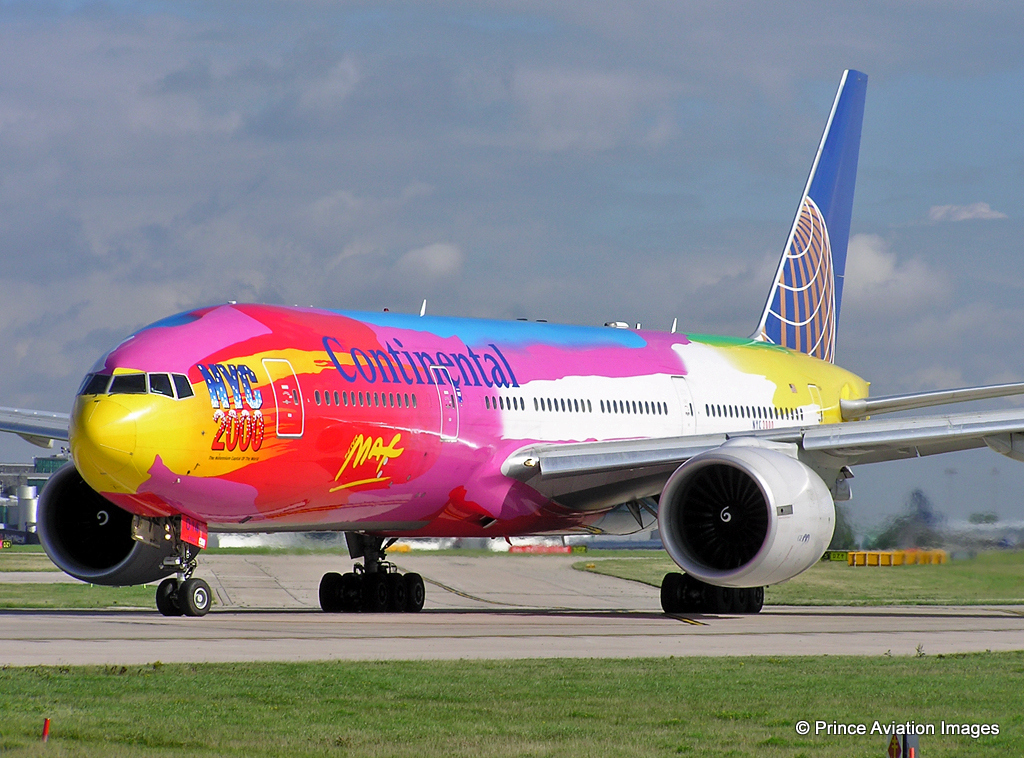 Continental's very colourful B777-200 N77014 NYC2000 Livery (by Peter Max) was a popular sight for some at MAN in May 2004. Photo: Stuart Prince.
