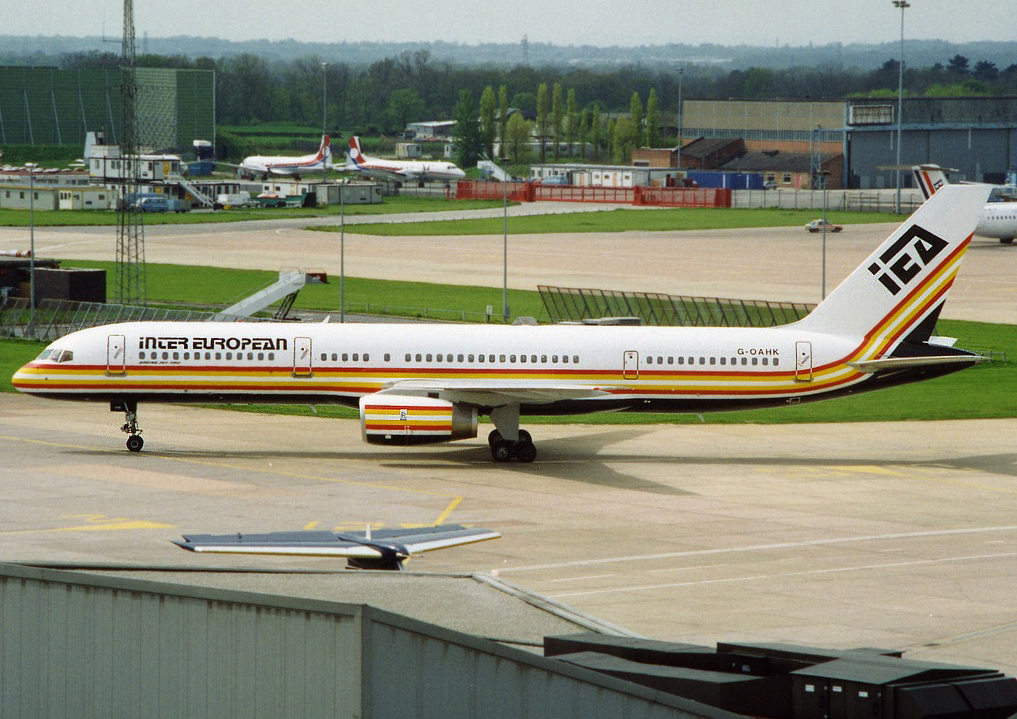 "Inter European B757-200 G-OAHK brings back memories for many….as will the ""Budgie"" corner behind the Airport Fire Station! Photo : Stuart Prince May 1992."