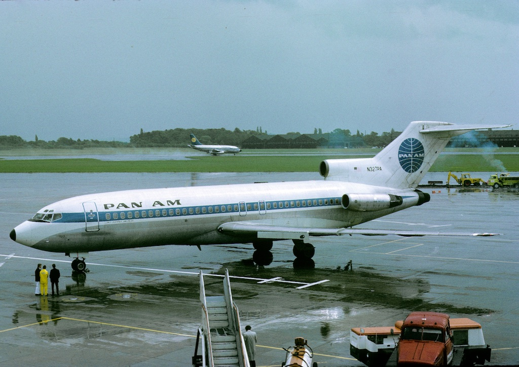 "A number of Pan Am Boeing 727's were based in Germany in the Seventies operating primarily connecting services to their long haul ops. N327PA is seen here at the end of Pier B in May 1973 which on this occasion - 30th May, was bringing in delegates to the Manchester ""Golden Products Conference"" . Thanks to Rick Skoroszewski for sharing this classic shot which looks like it was photo bombed by a Lufthansa classic B737…"