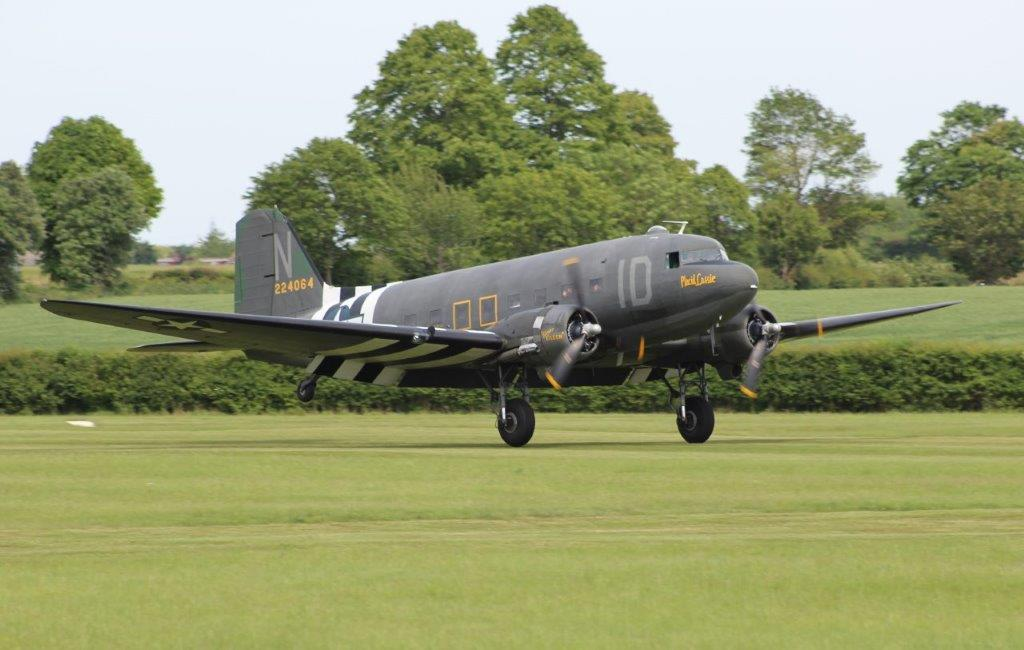 "D-Day veteran ""Placid Lassie"" N74589 /42-24064 touching down at Old Warden on 1st June. Photo: Tom Hunter."