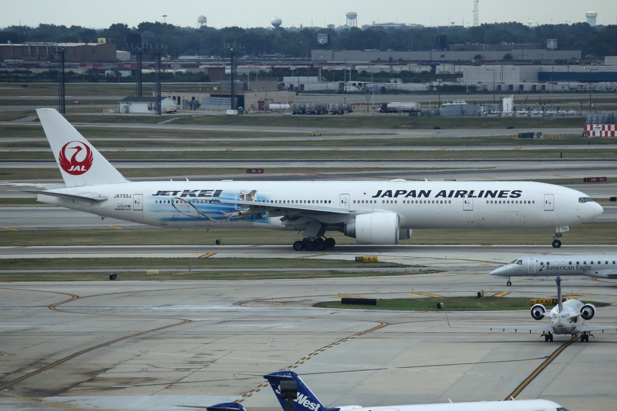 """JA733J Japan Airlines """"JET KEI"""" B777-3 taken from Hilton Hotel at Chicago O'Hare Airport 21st July by John Wood"""