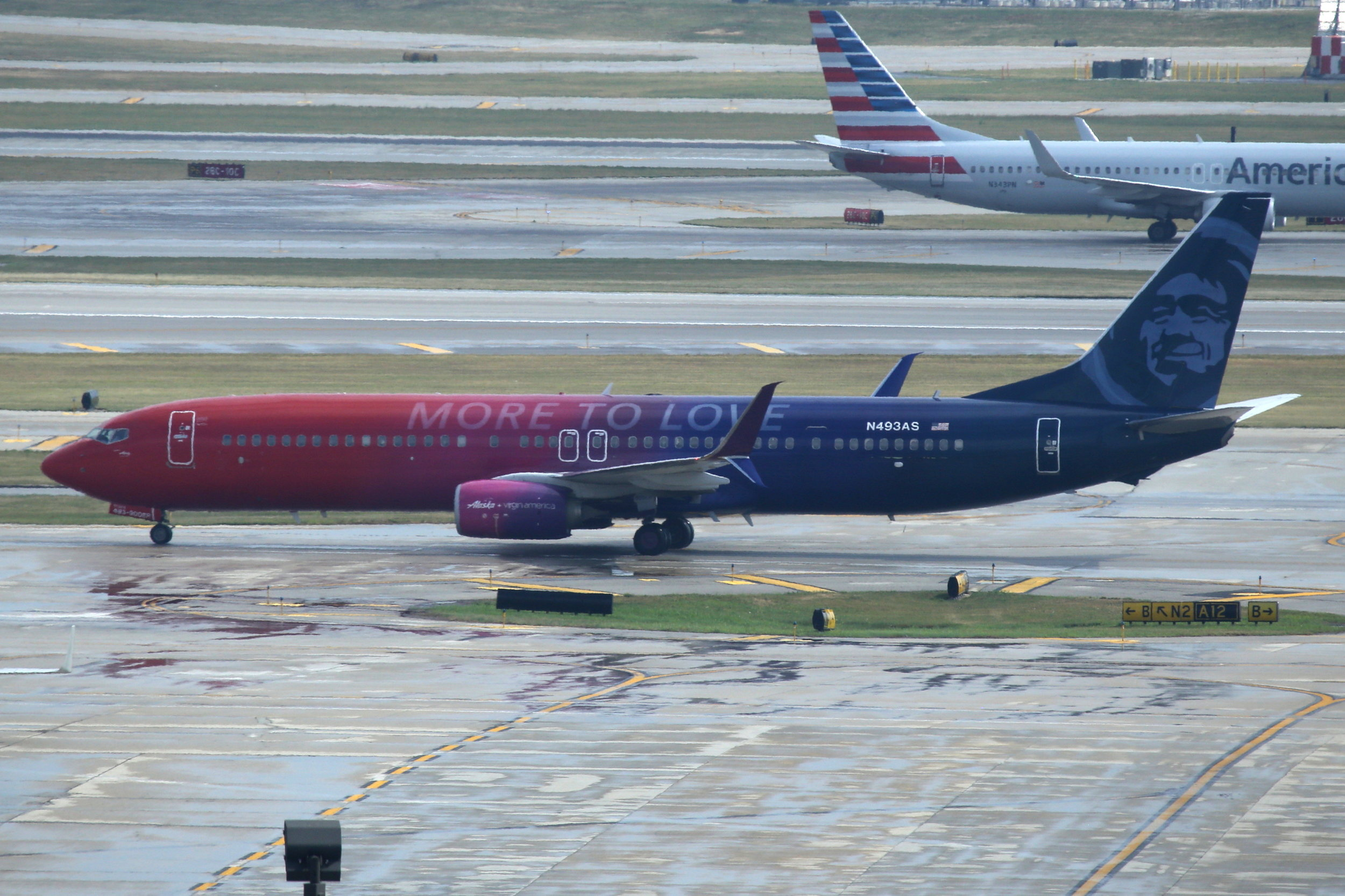 """N493AS Alaska B737-8W """"More to love"""" taken from the Hilton Hotel at Chicago O'Hare Airport 21st July 2018 by John Wood"""