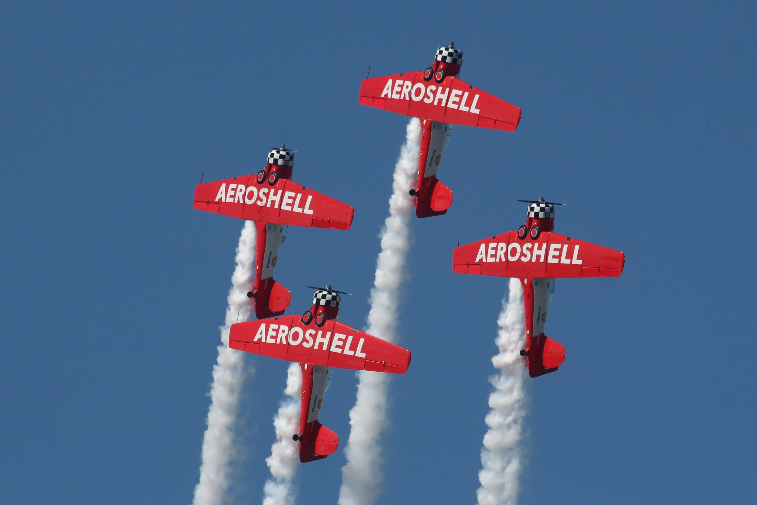 Aeroshell Aerobatic display team flying T-6 Texan's displaying at Oshkosh 25th July 2018 taken by Andrew Tenny
