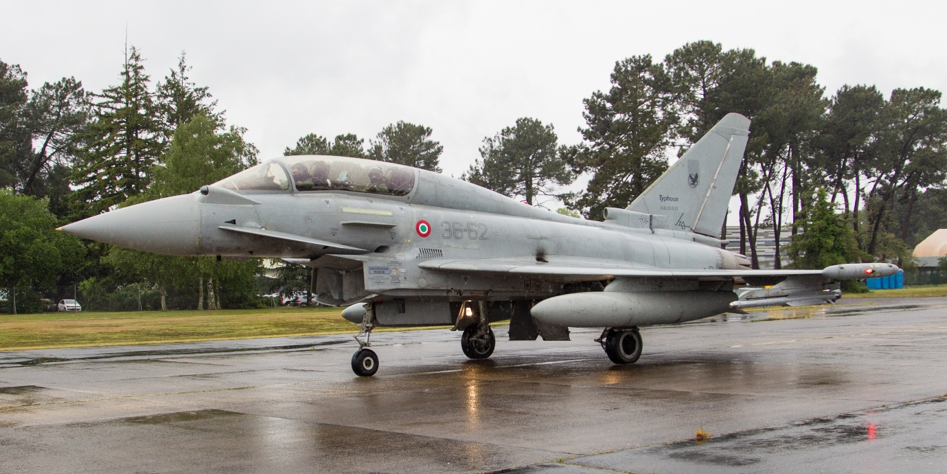 Photo: Italian Air Force Typhoon serial MM55902 taxiing out at a very wet MDM. Debbie Riley