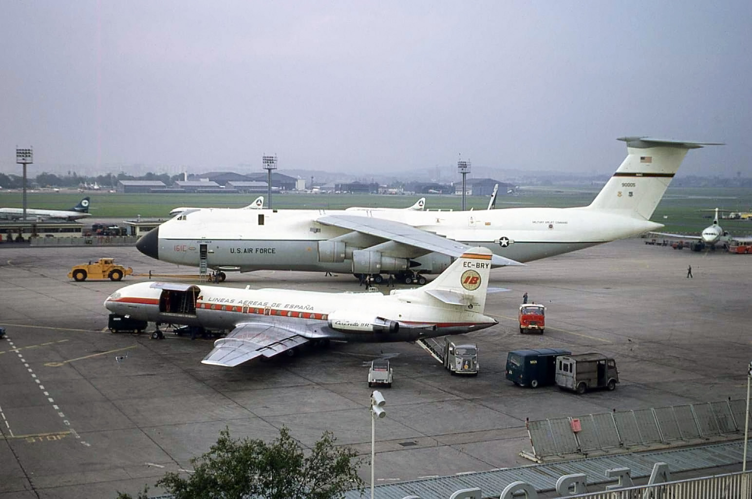 Paris Le Bourget - September 1971 and an Iberia Caravelle is dwarfed by a mighty USAF C5 Galaxy. What else can we see? A number of Caravelles,Daks, a Cyprus ? Trident and a UTA Dc8.. This was my favourite airport as it always had a few surprises in store