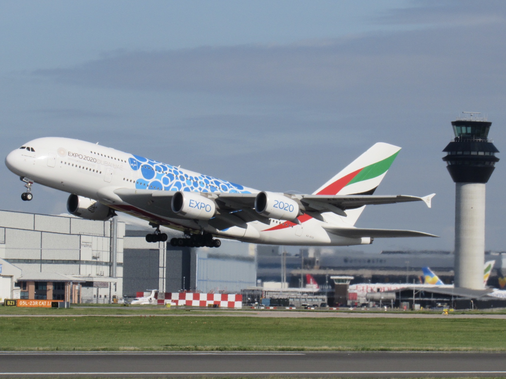 A super image from Lewis Rowland of the Emirates A380 A6-EOS in the Blue Expo 2020 Livery departing Manchester today (8th September) on the EK022 to Dubai.