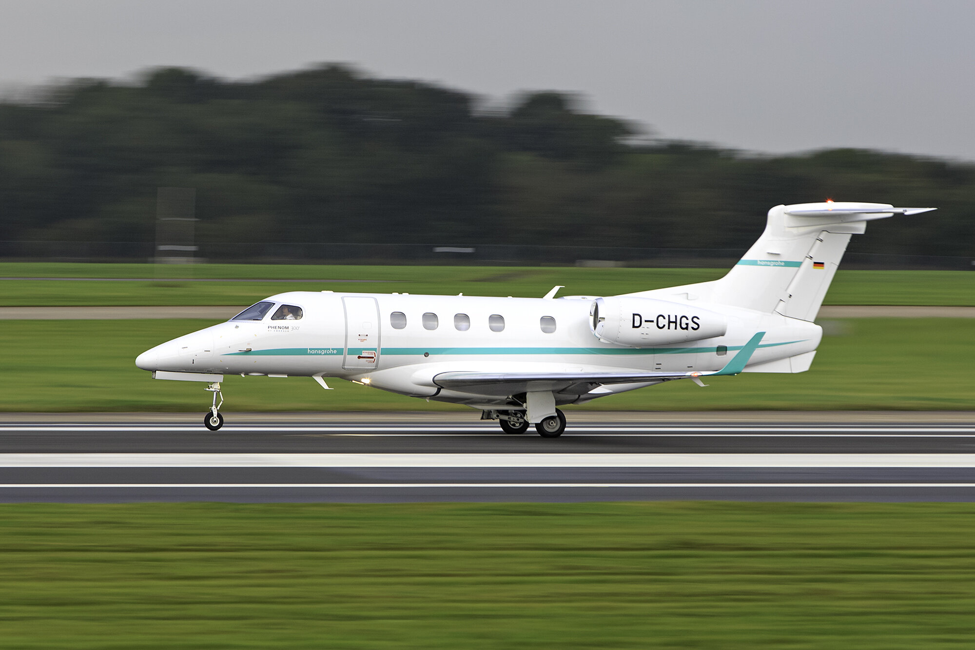 Embraer Phenom 300 D-CHGS departing on Runway 23 Left. 25th September 2019. Photo: Paul Bailey